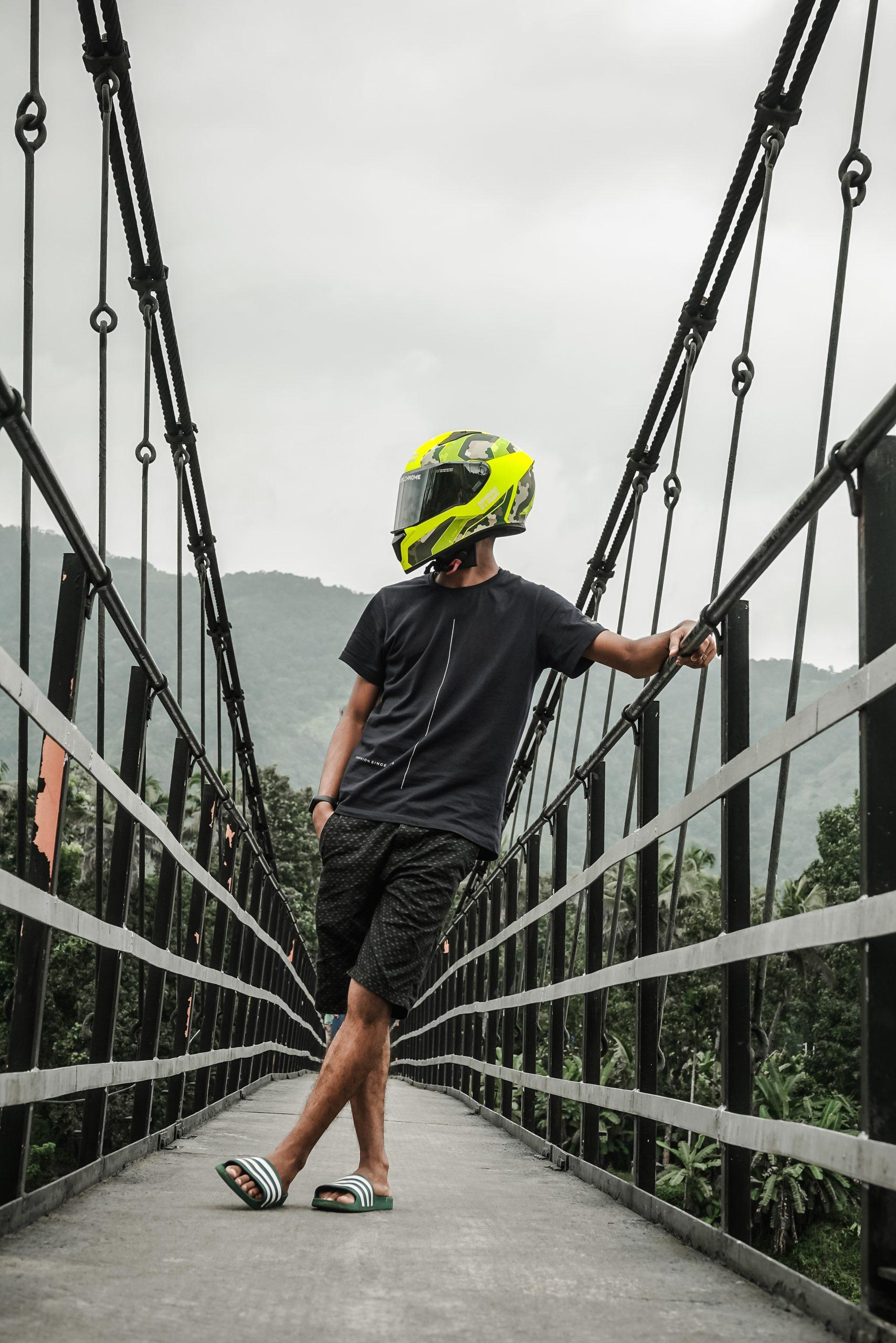 boy with helmet on bridge