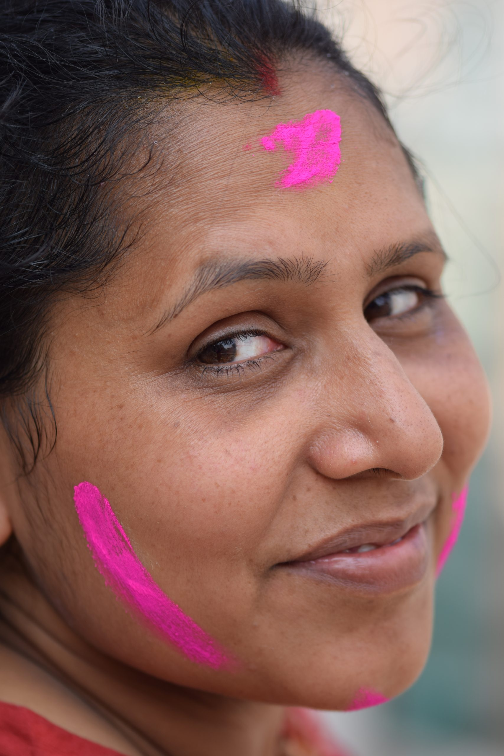 Holi color on woman face