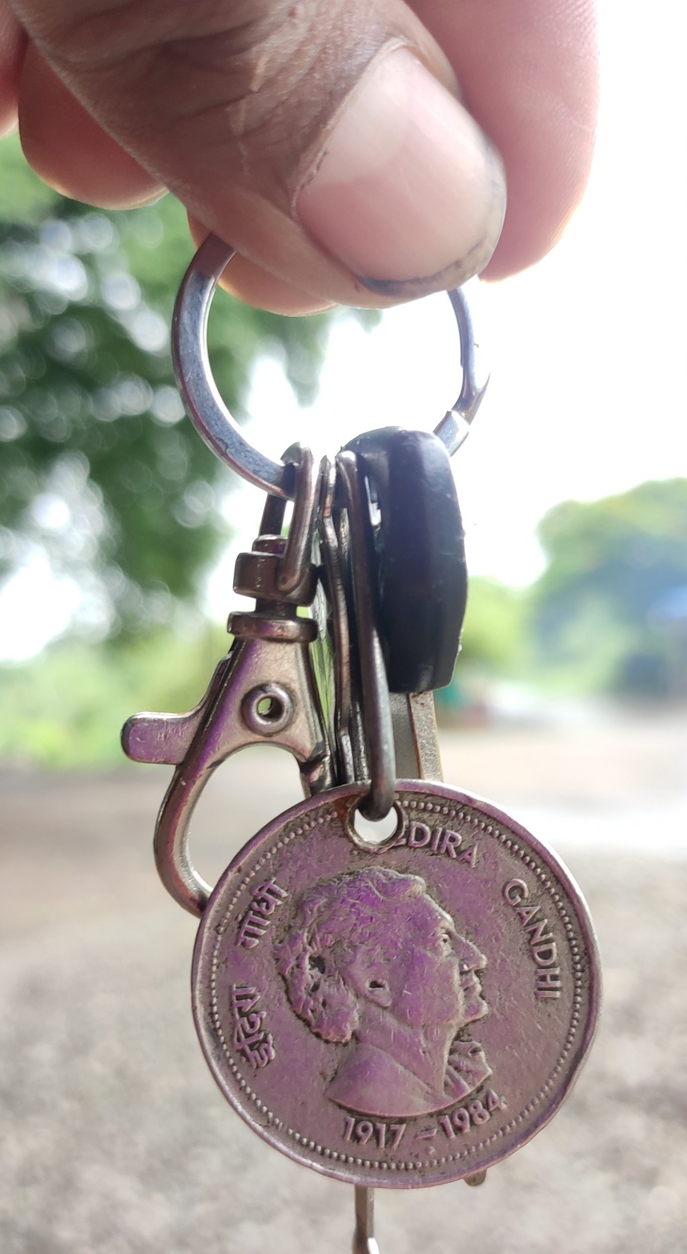 indian coin as a keychain