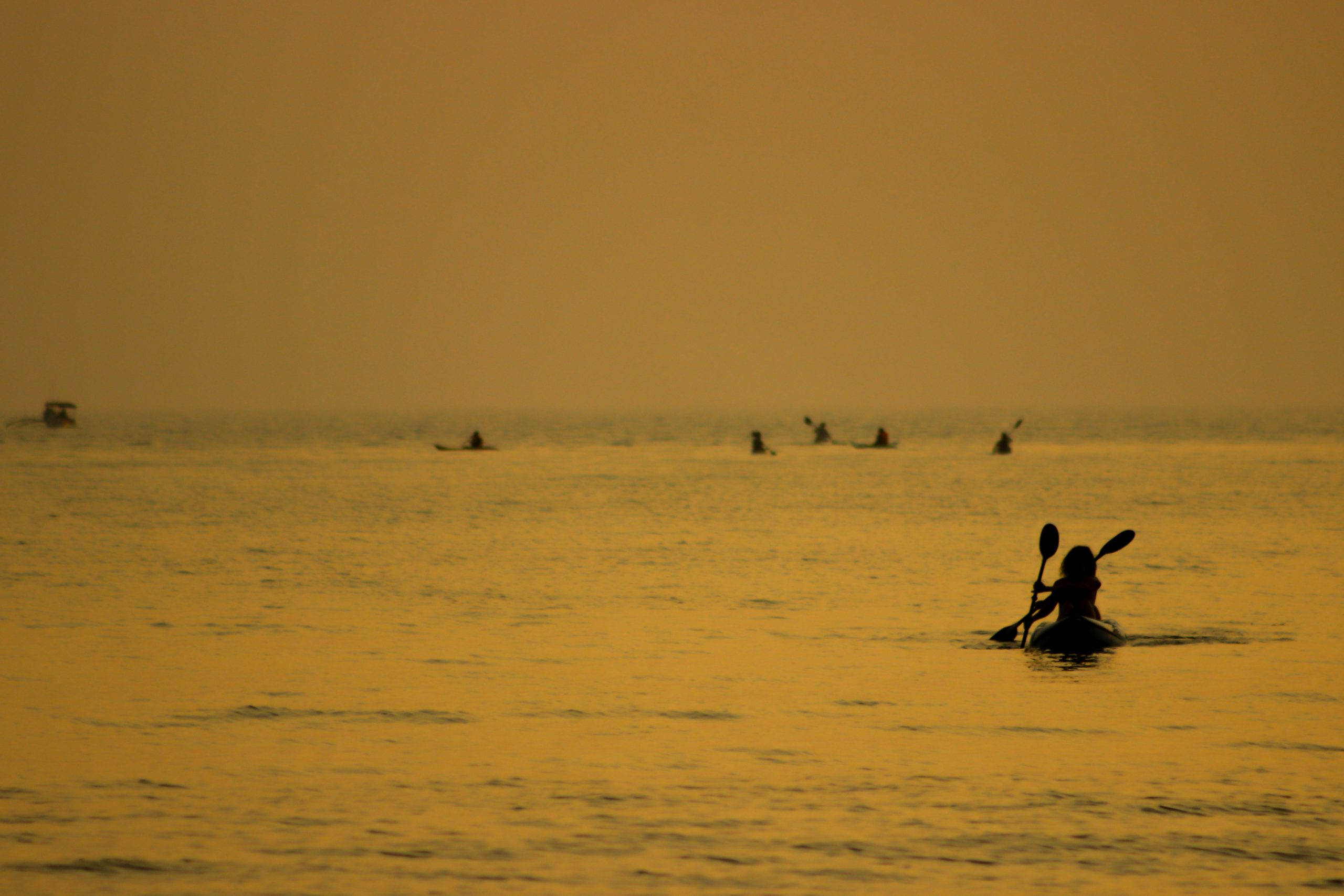 Kayaking in sea during evening hours