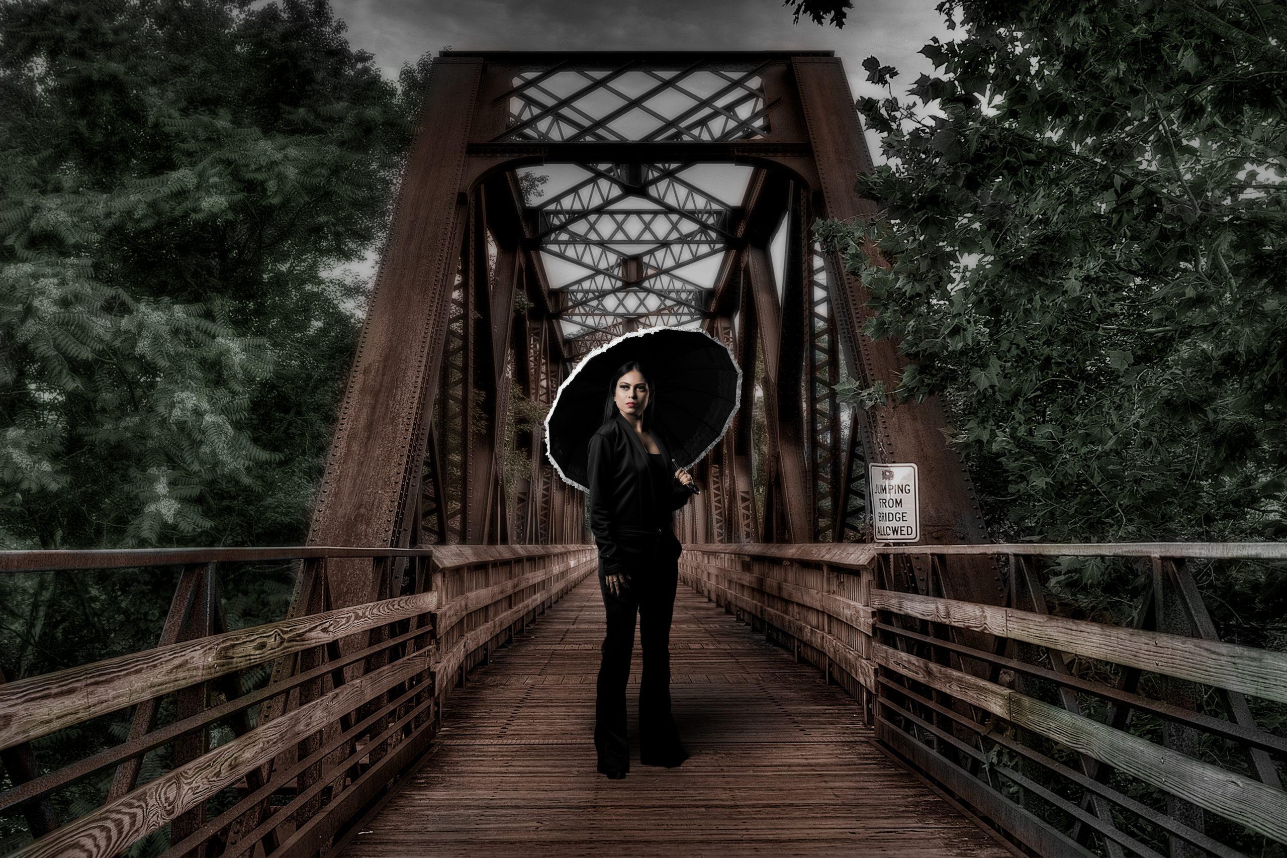 woman with umbrella on bridge