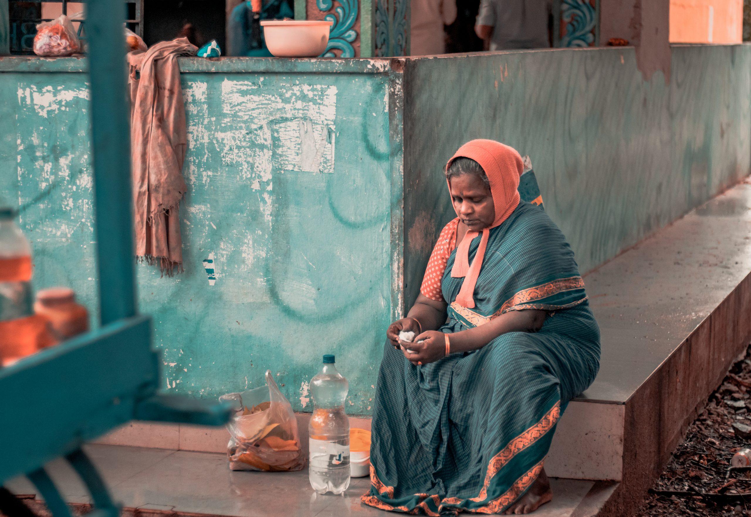 lady sitting near a shop
