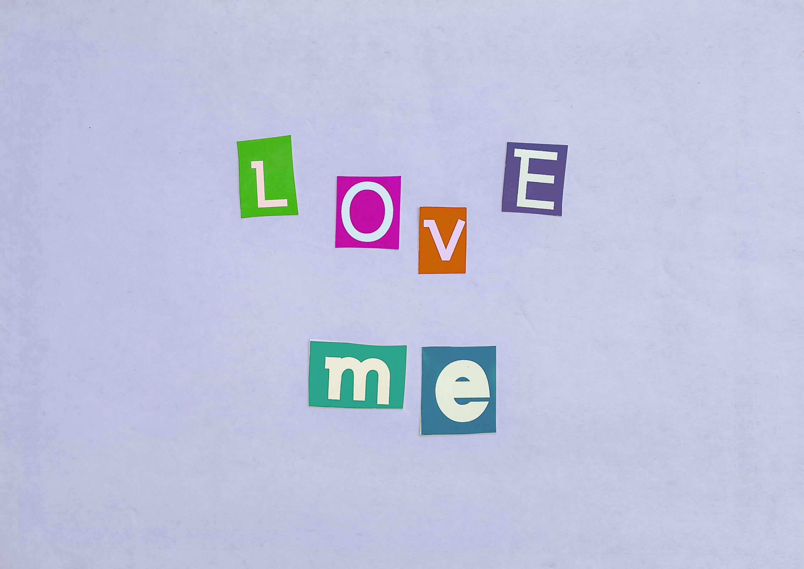 Love me written with stickers