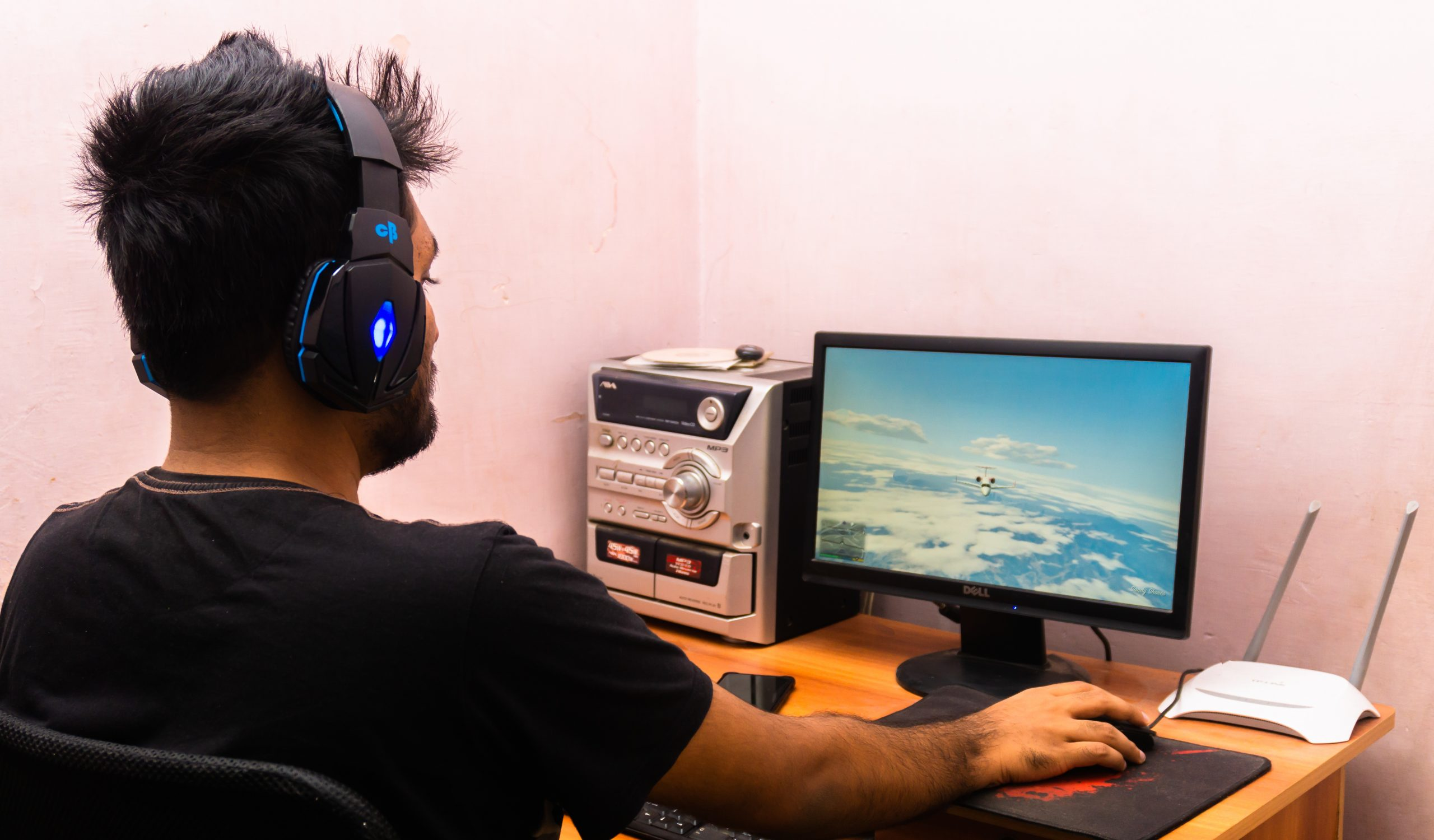man using computer and headphones