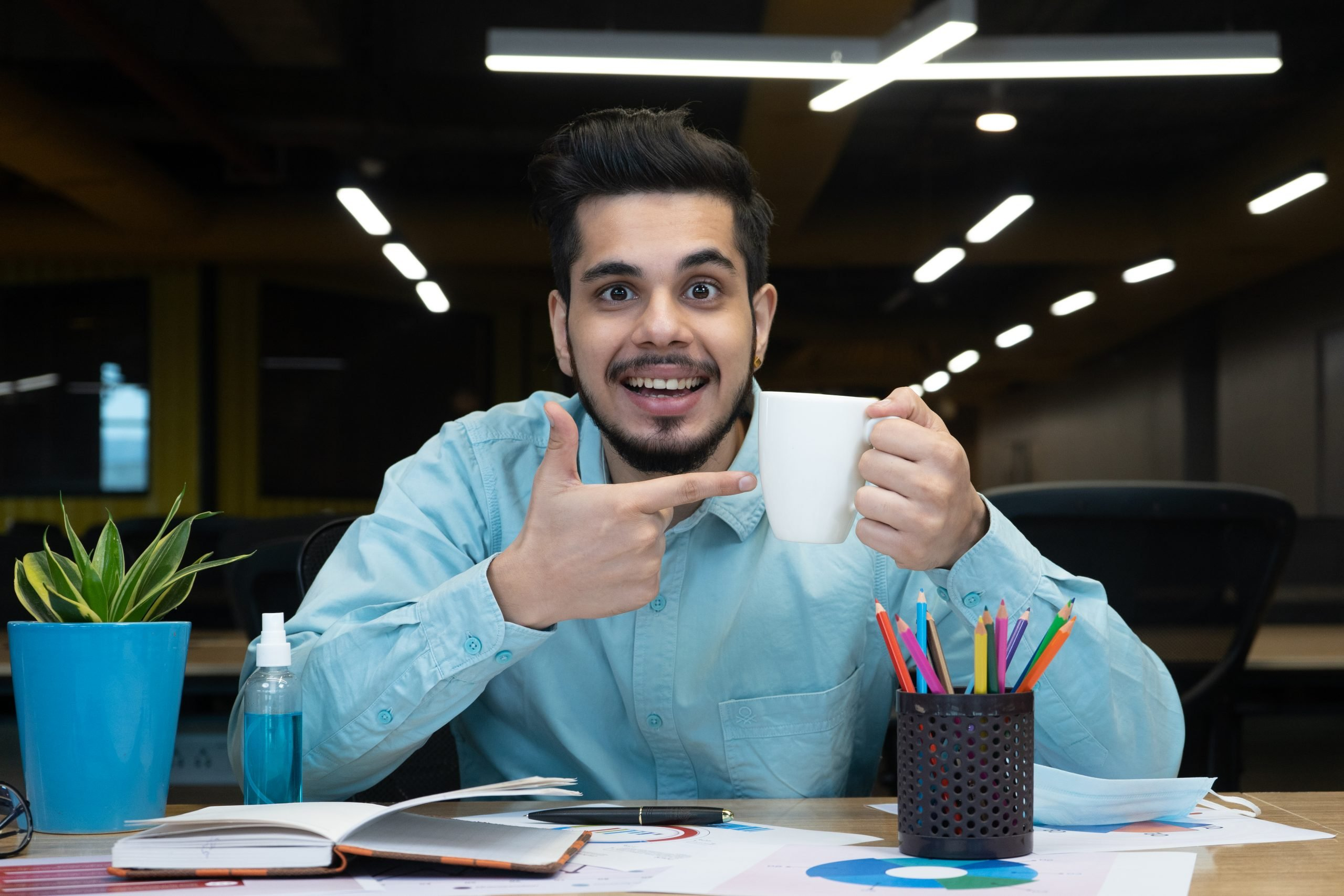 Man pointing to coffee mug