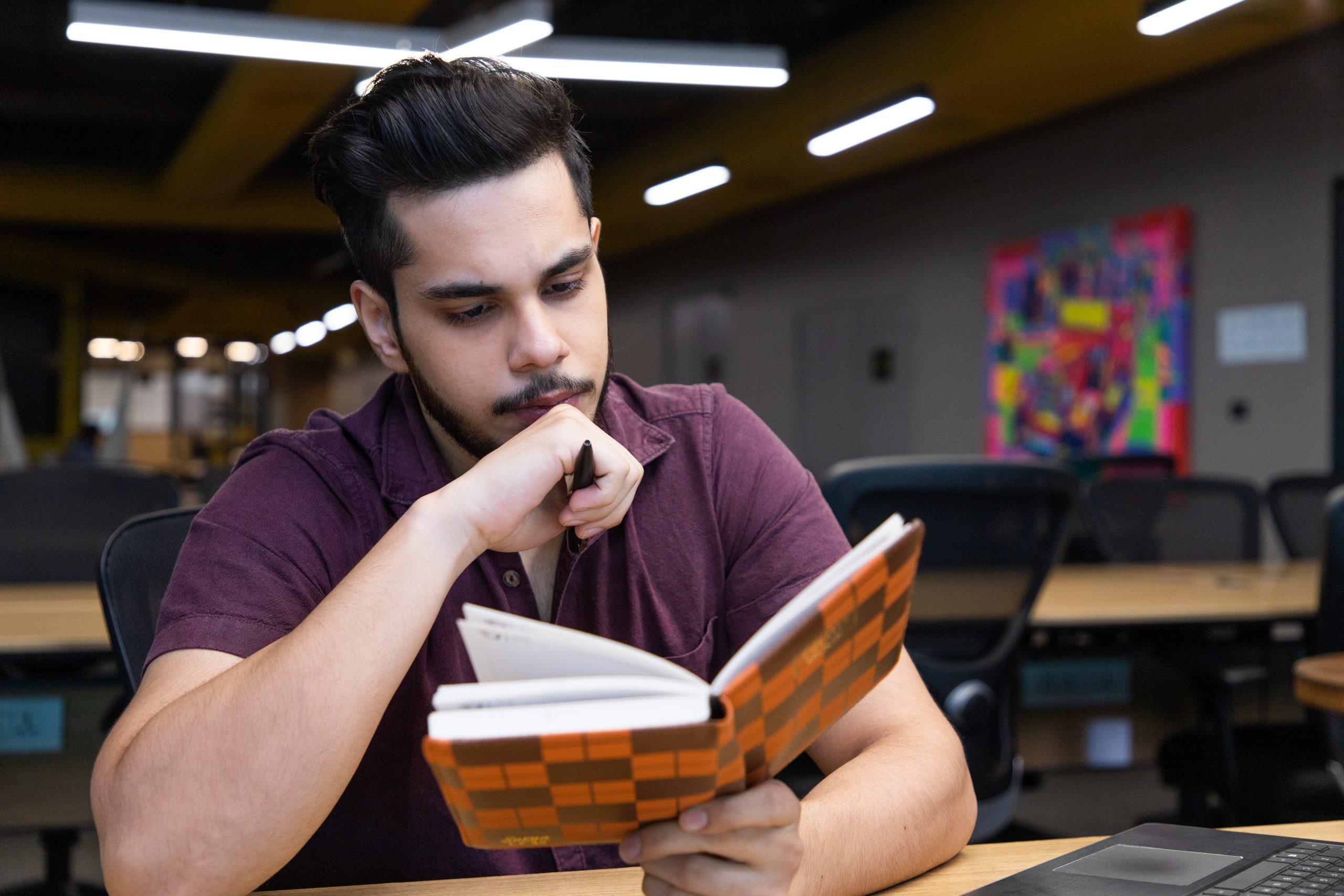Man reading diary
