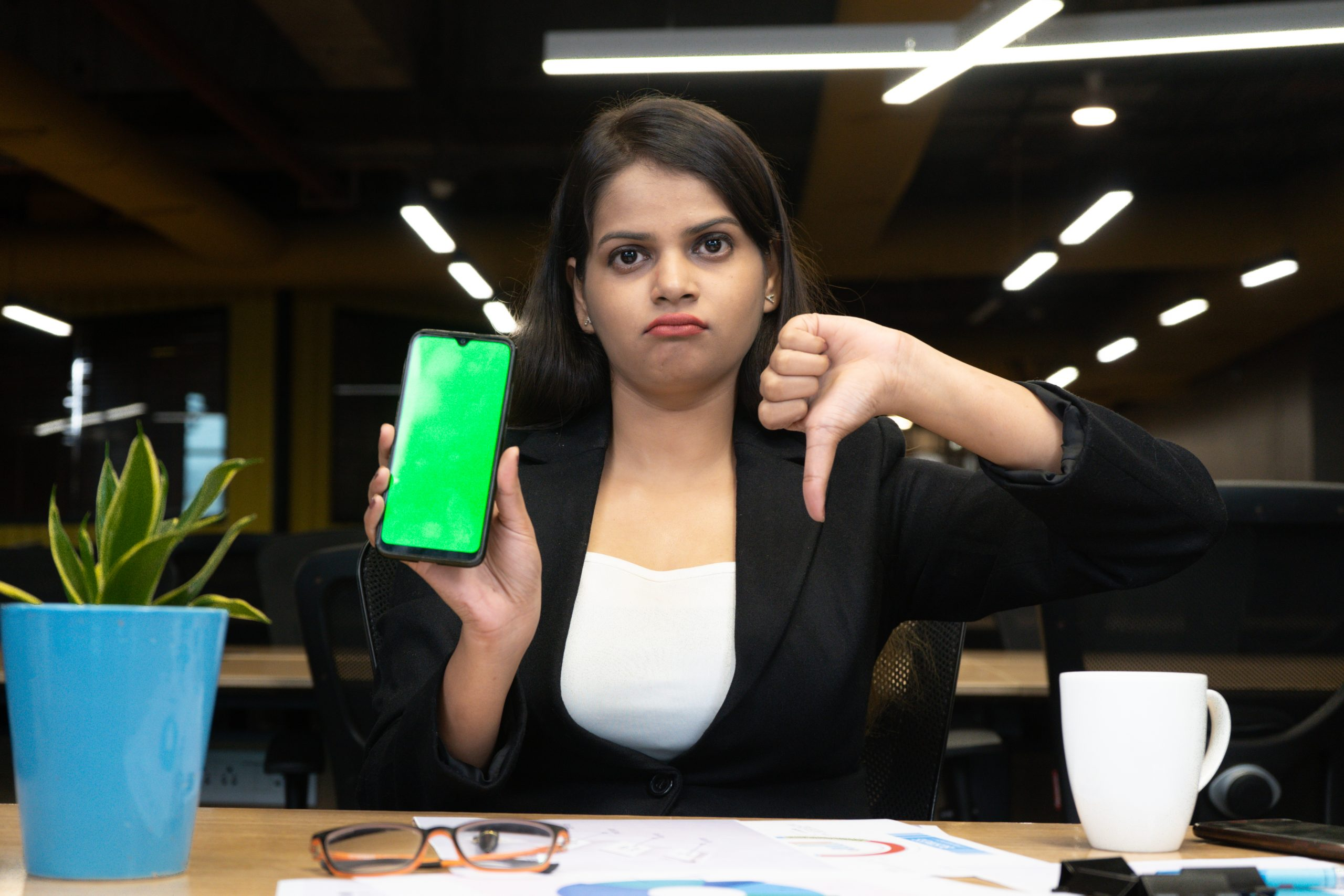 Manager pointing dislike about phone