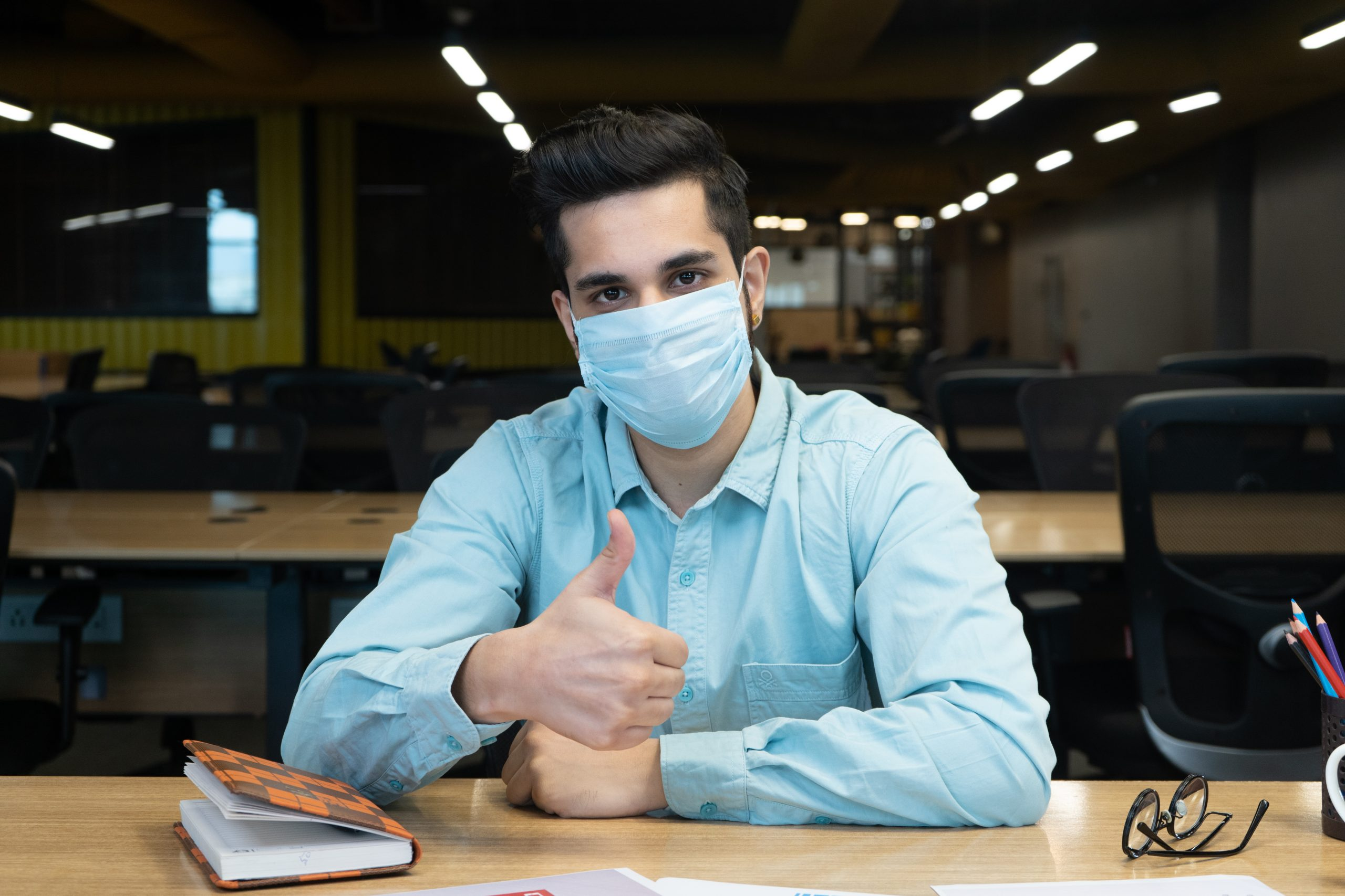 man with mask in office
