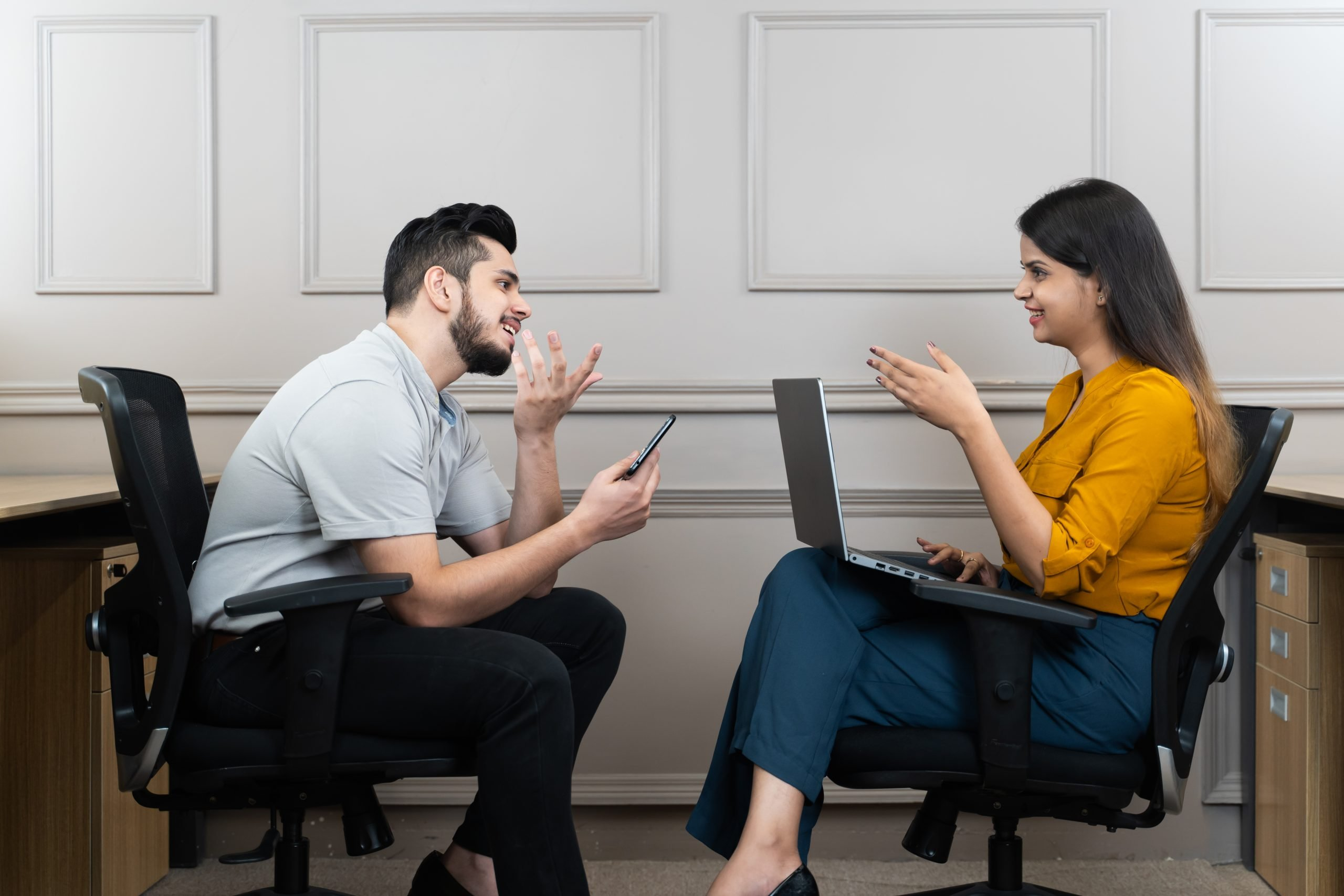 Office colleagues talking with each other