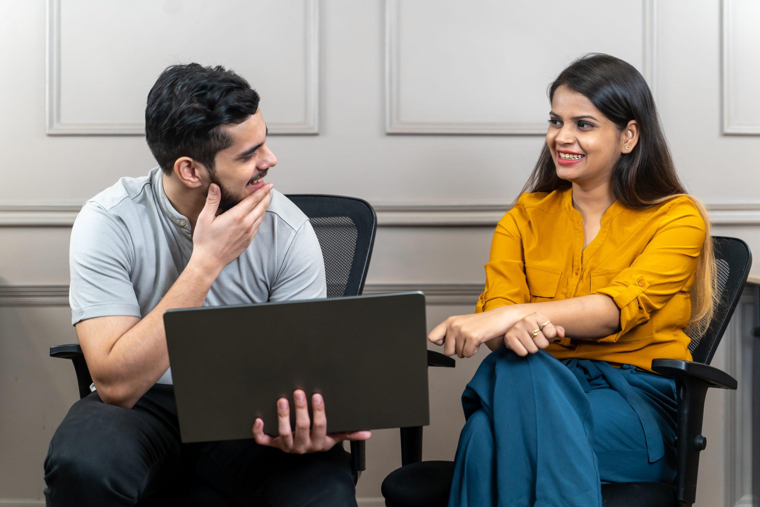 Office employees gossiping