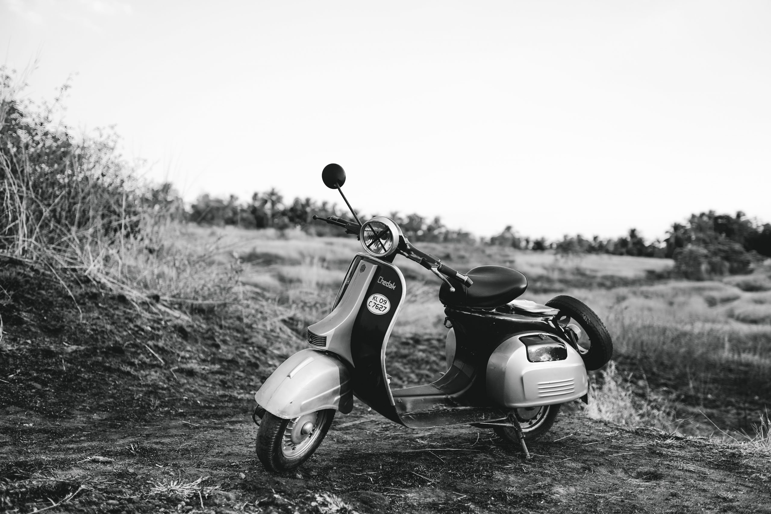An old scooter in black and white.