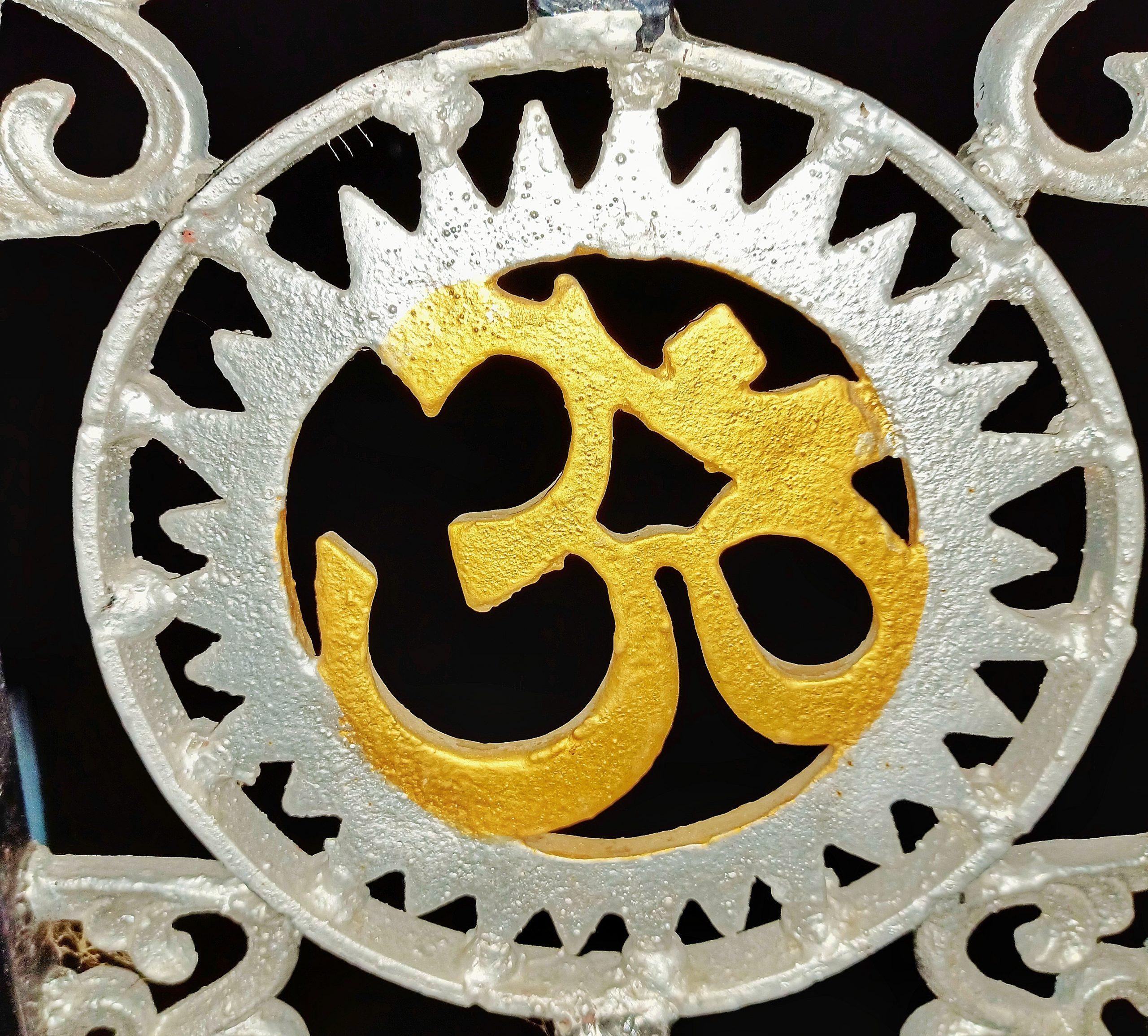 Om written on a metal structure