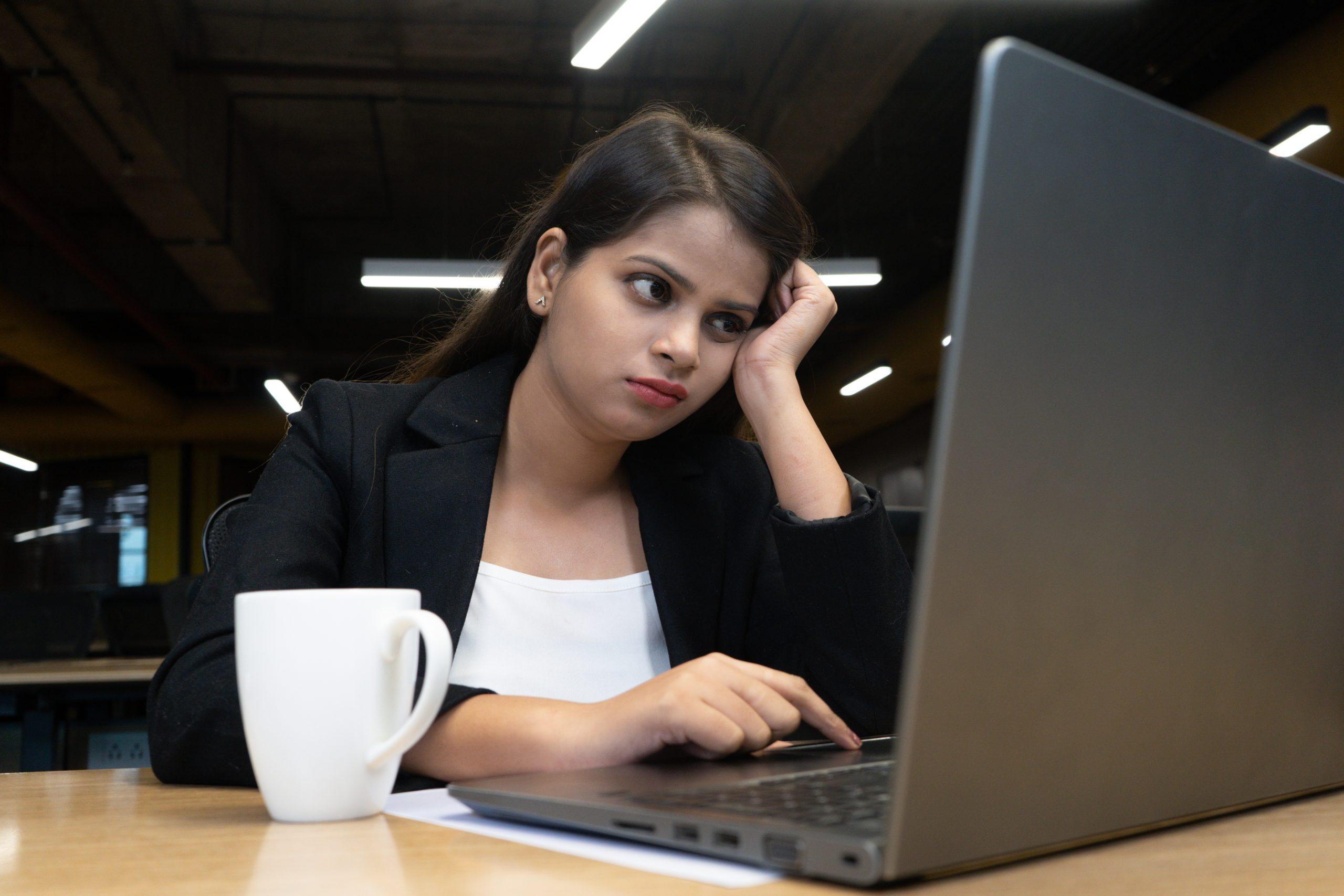 Overworked employee in office