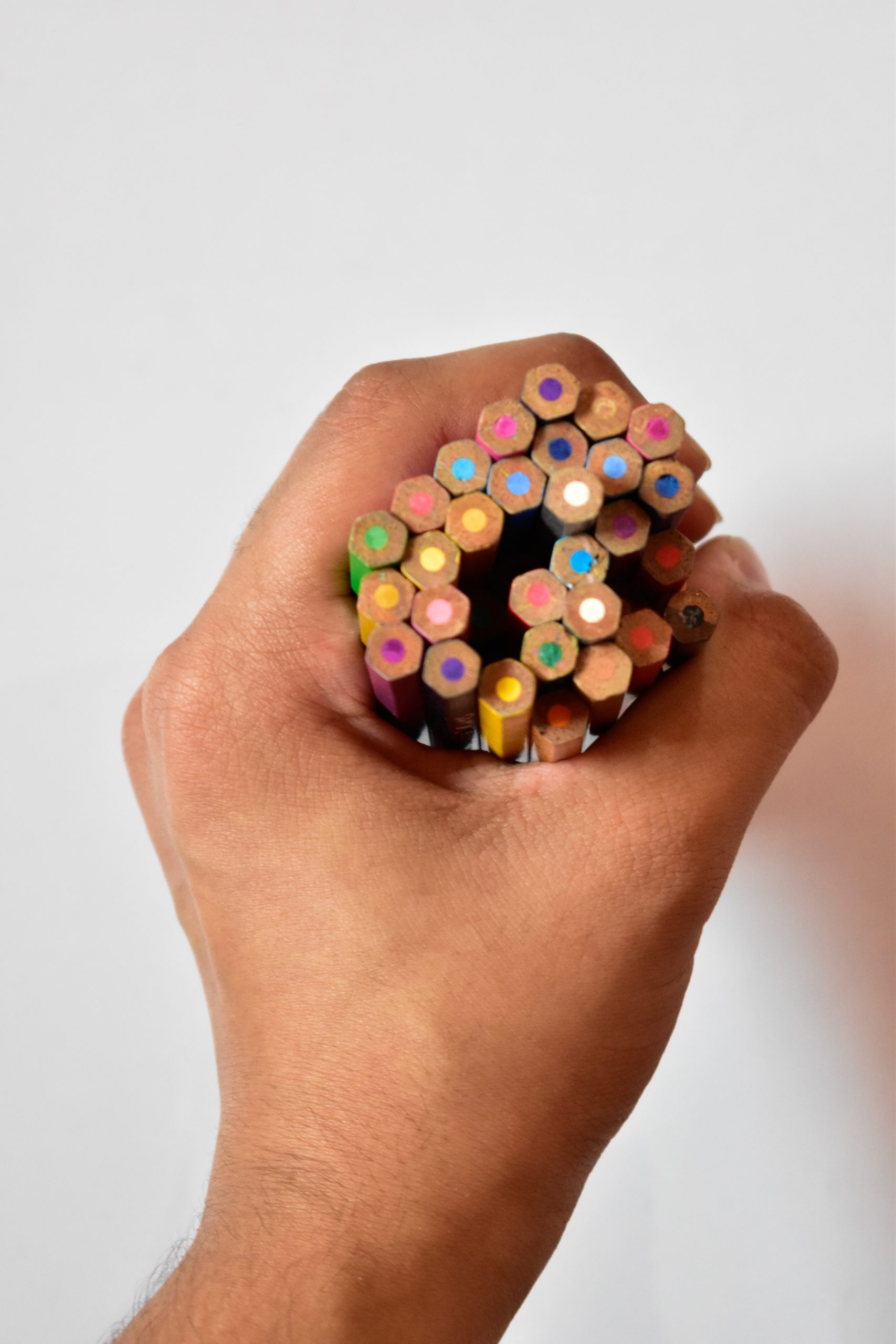 pencil colors in a hand