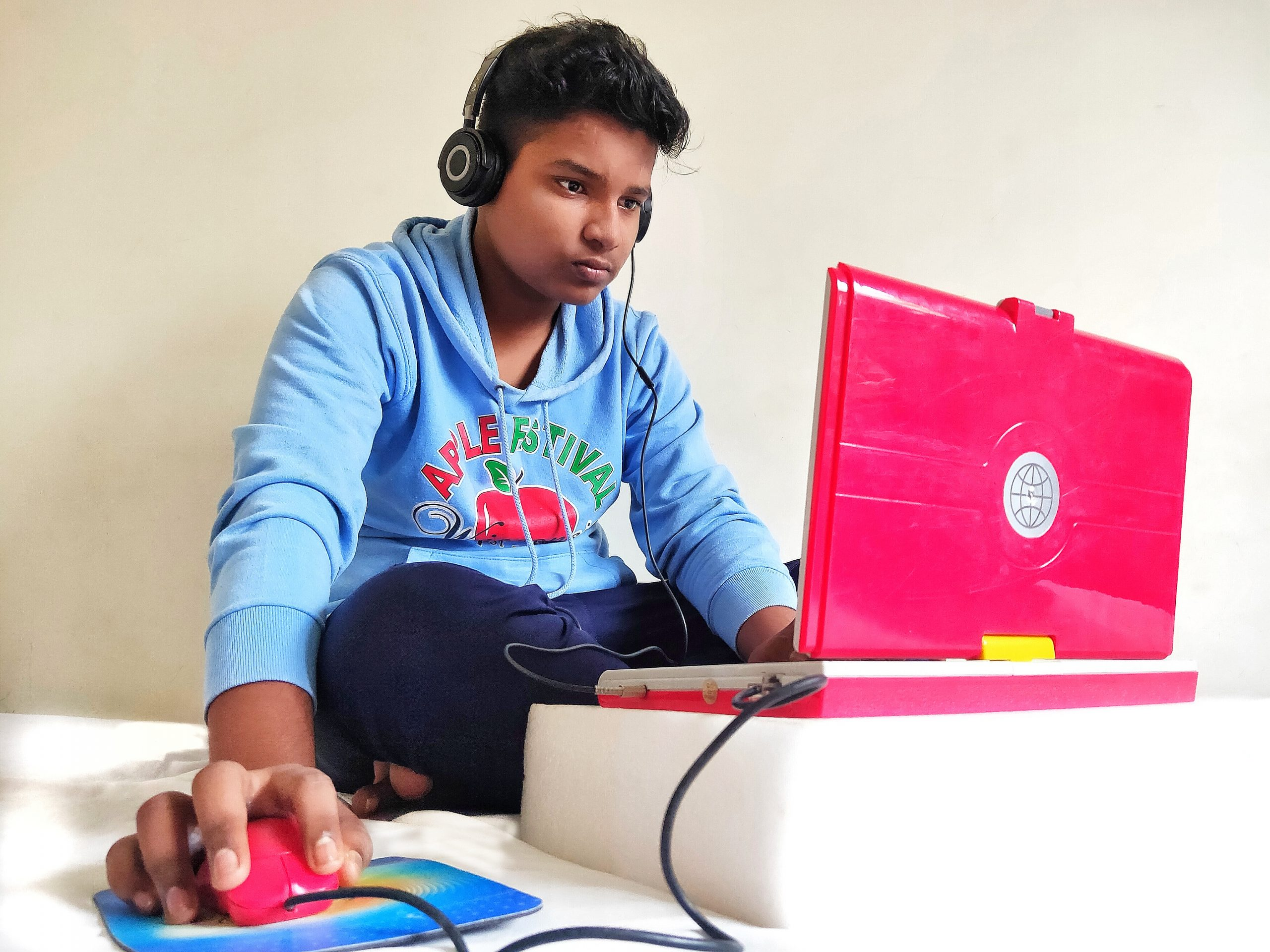 boy using laptop and headphones