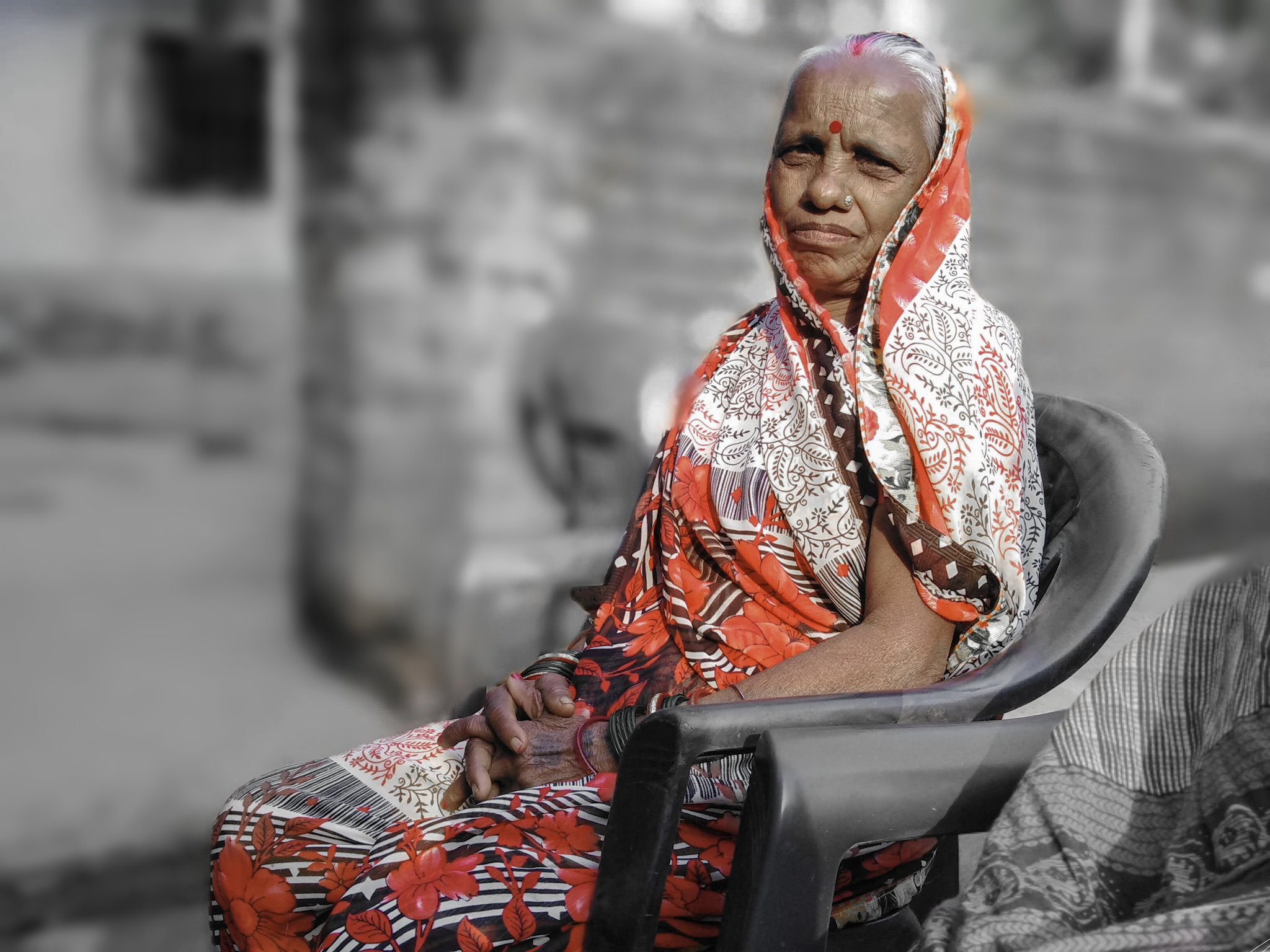An old lady on a chair