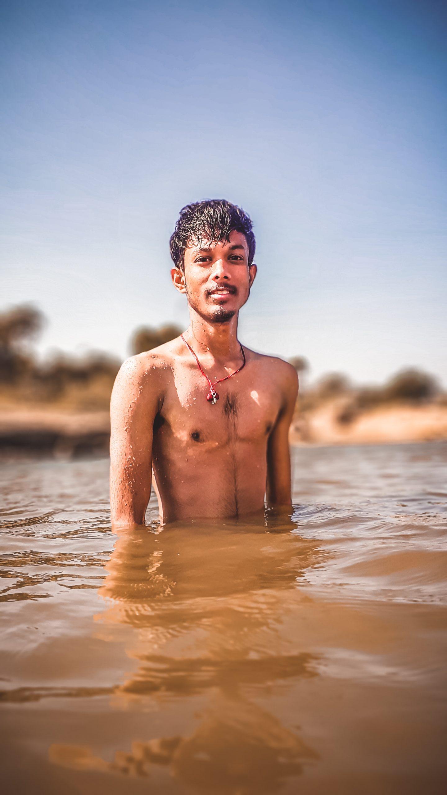 man posing in muddy water