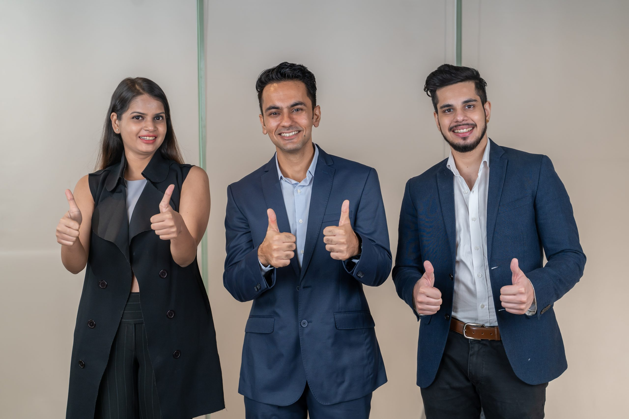 Professionals showing thumbs up