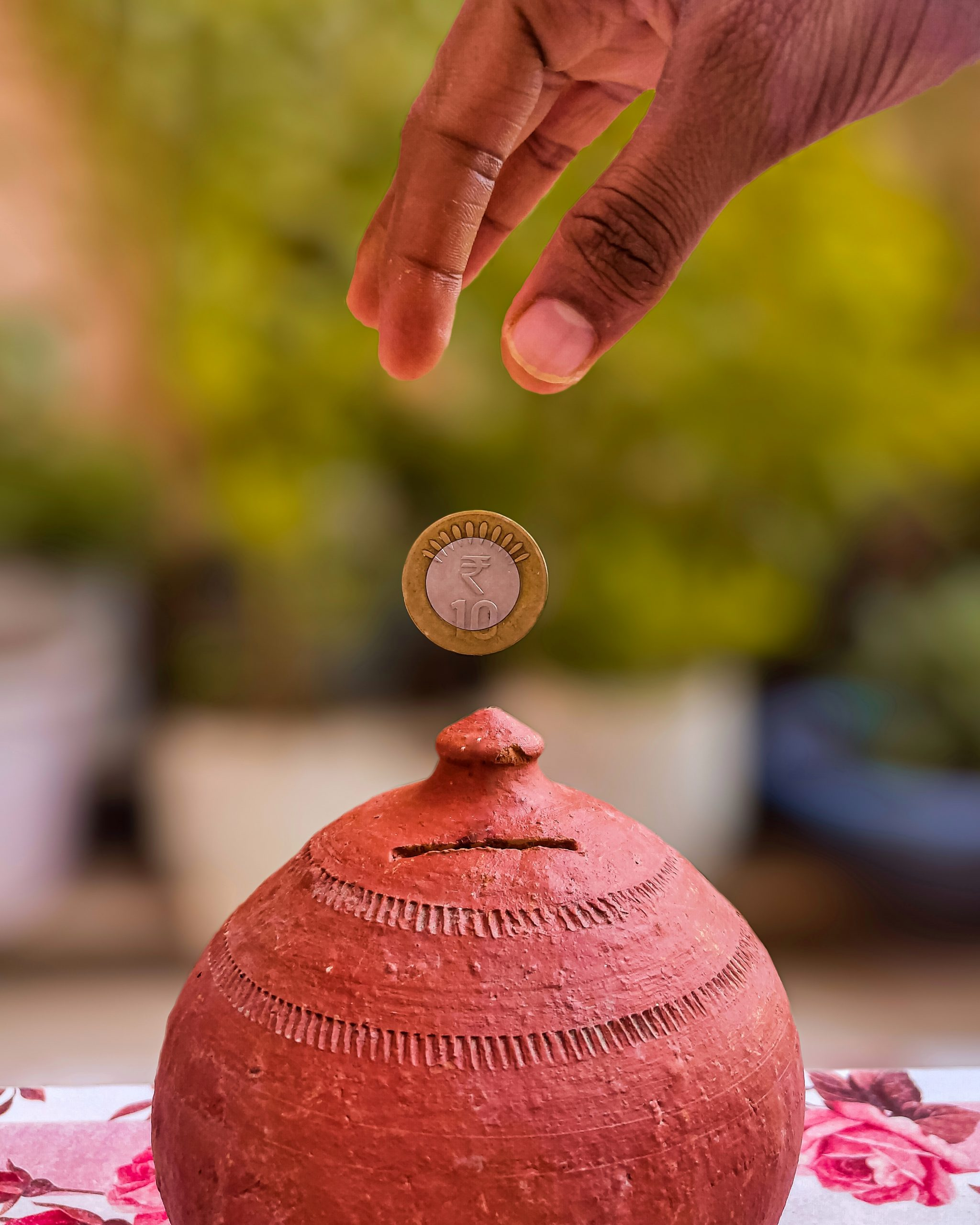 Putting coin in money bank