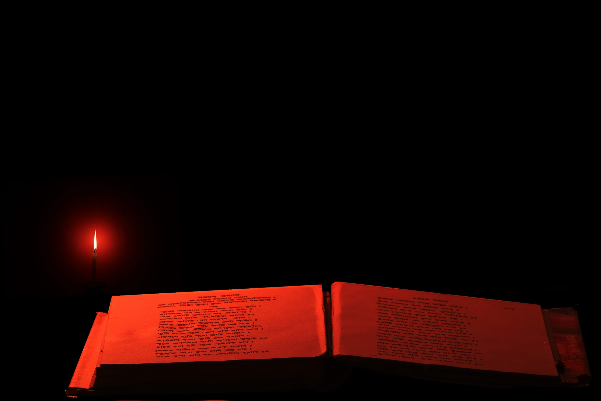 Reading a holy book in candle light