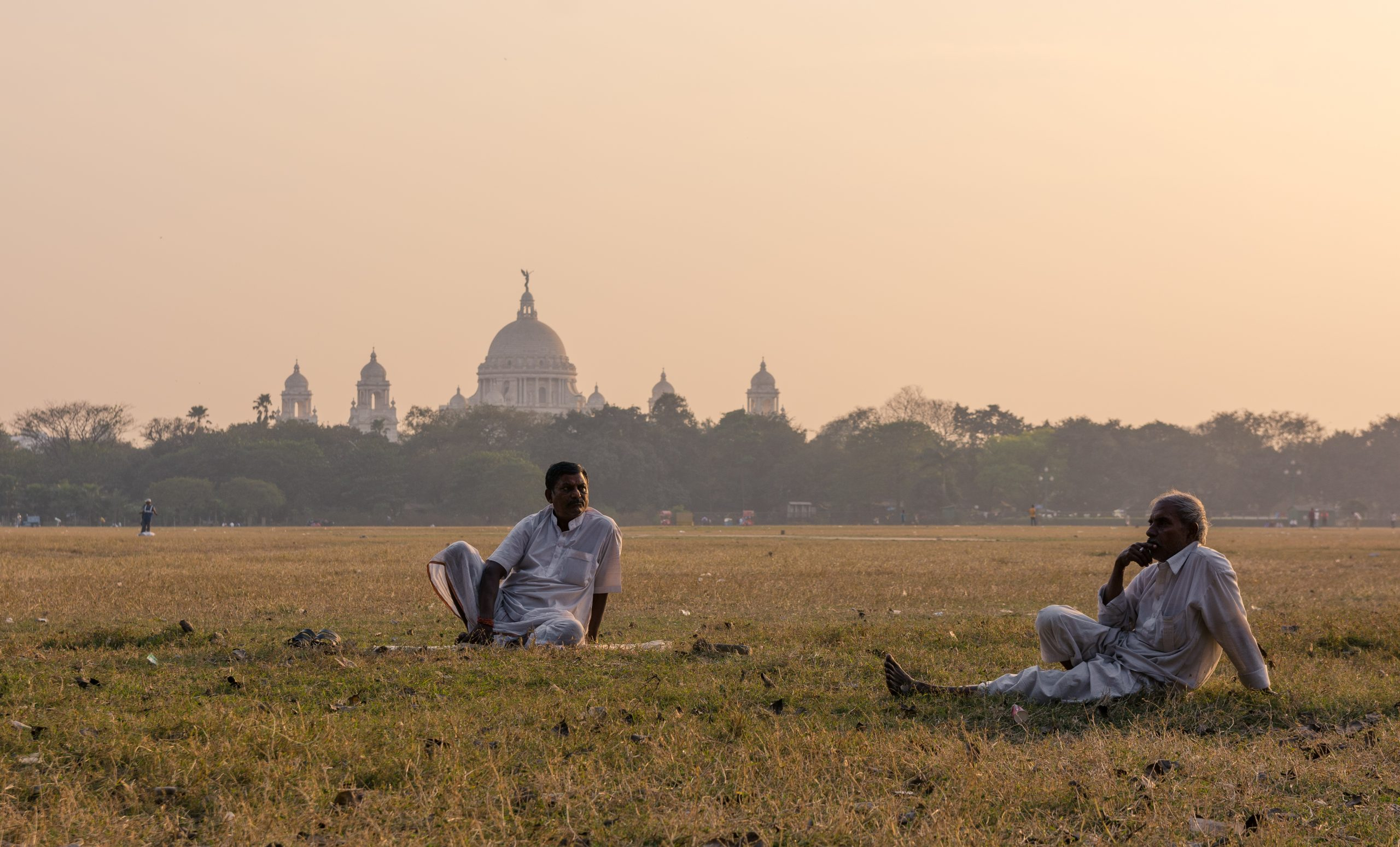 People sitting in ground