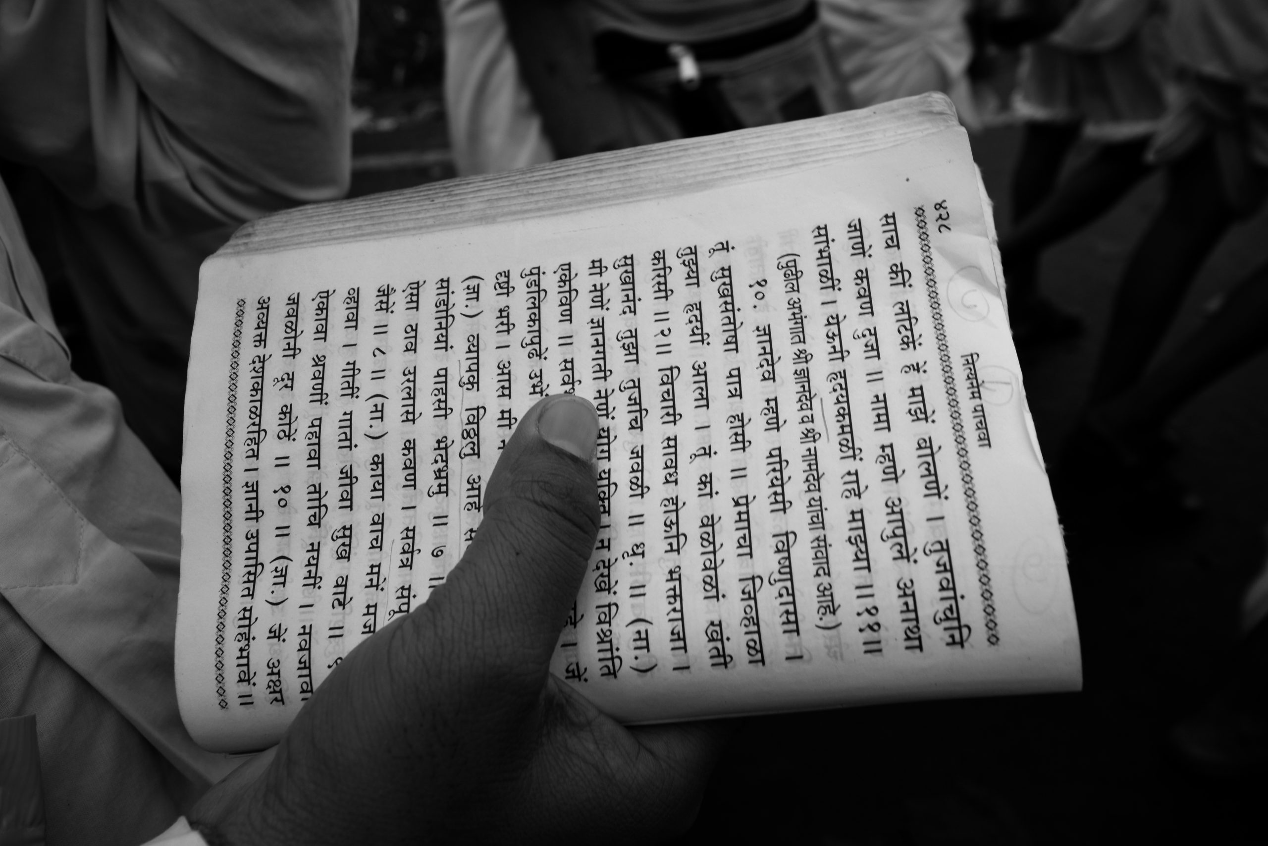 A religious book in hand