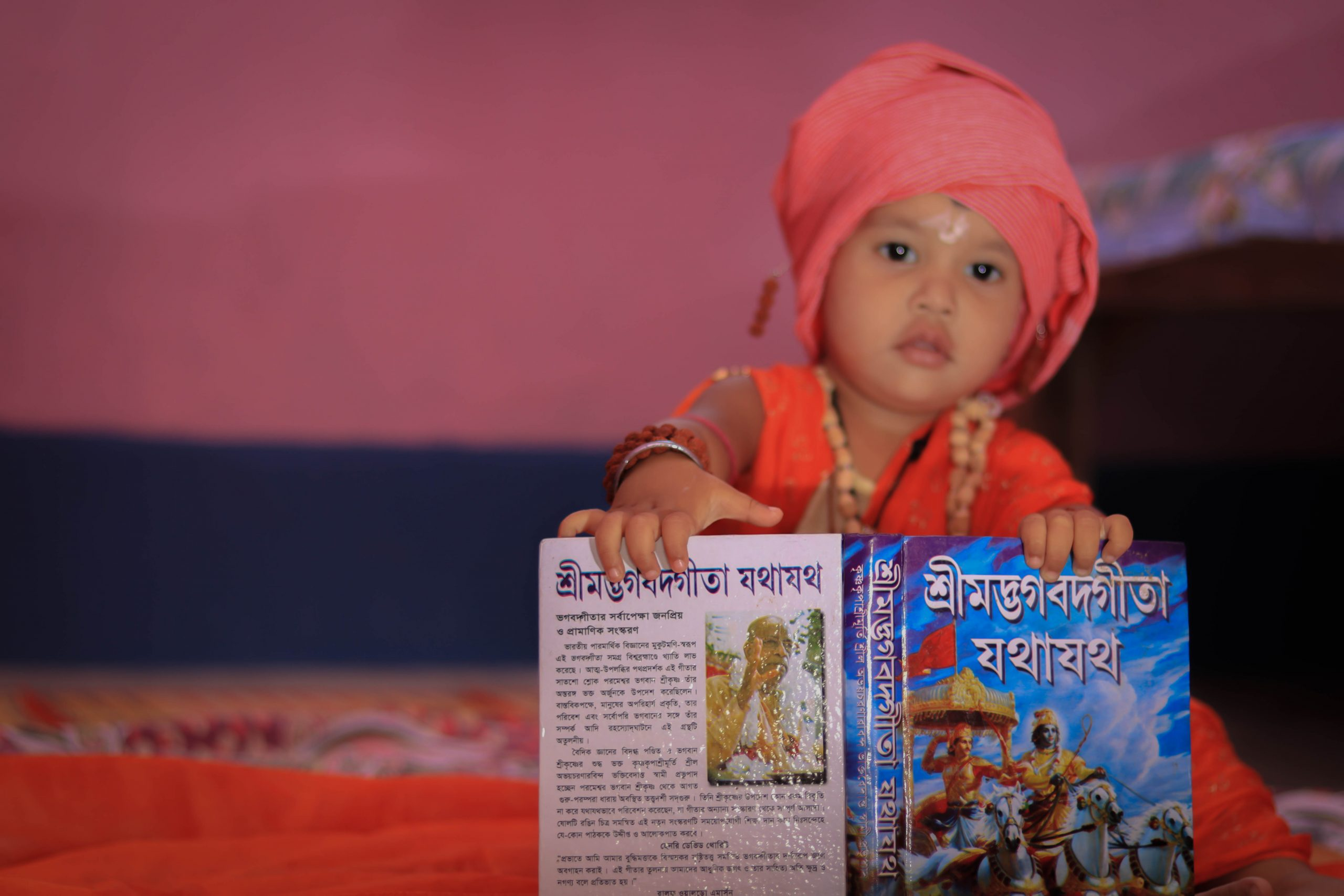 kid with religious book
