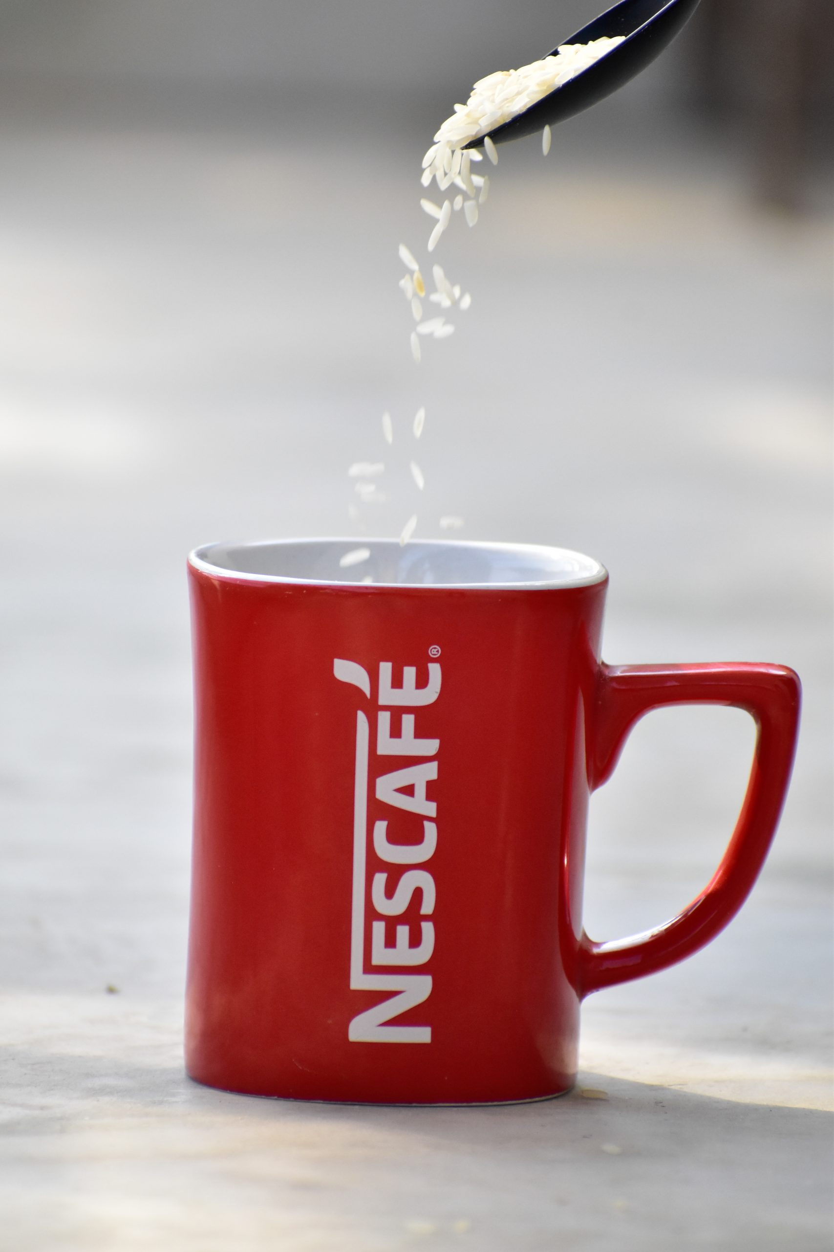 rice grains falling in a mug