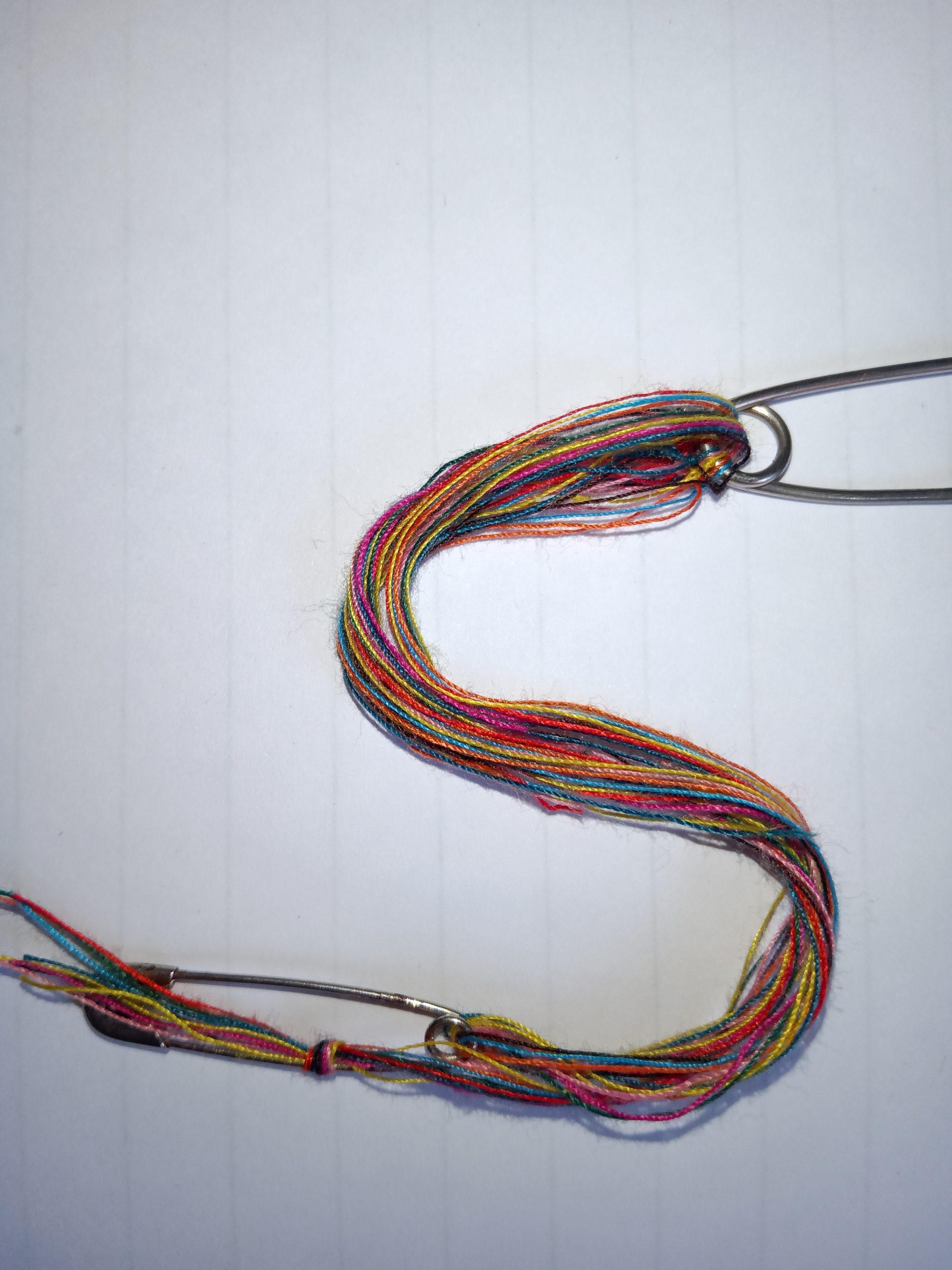 S written with woolen thread