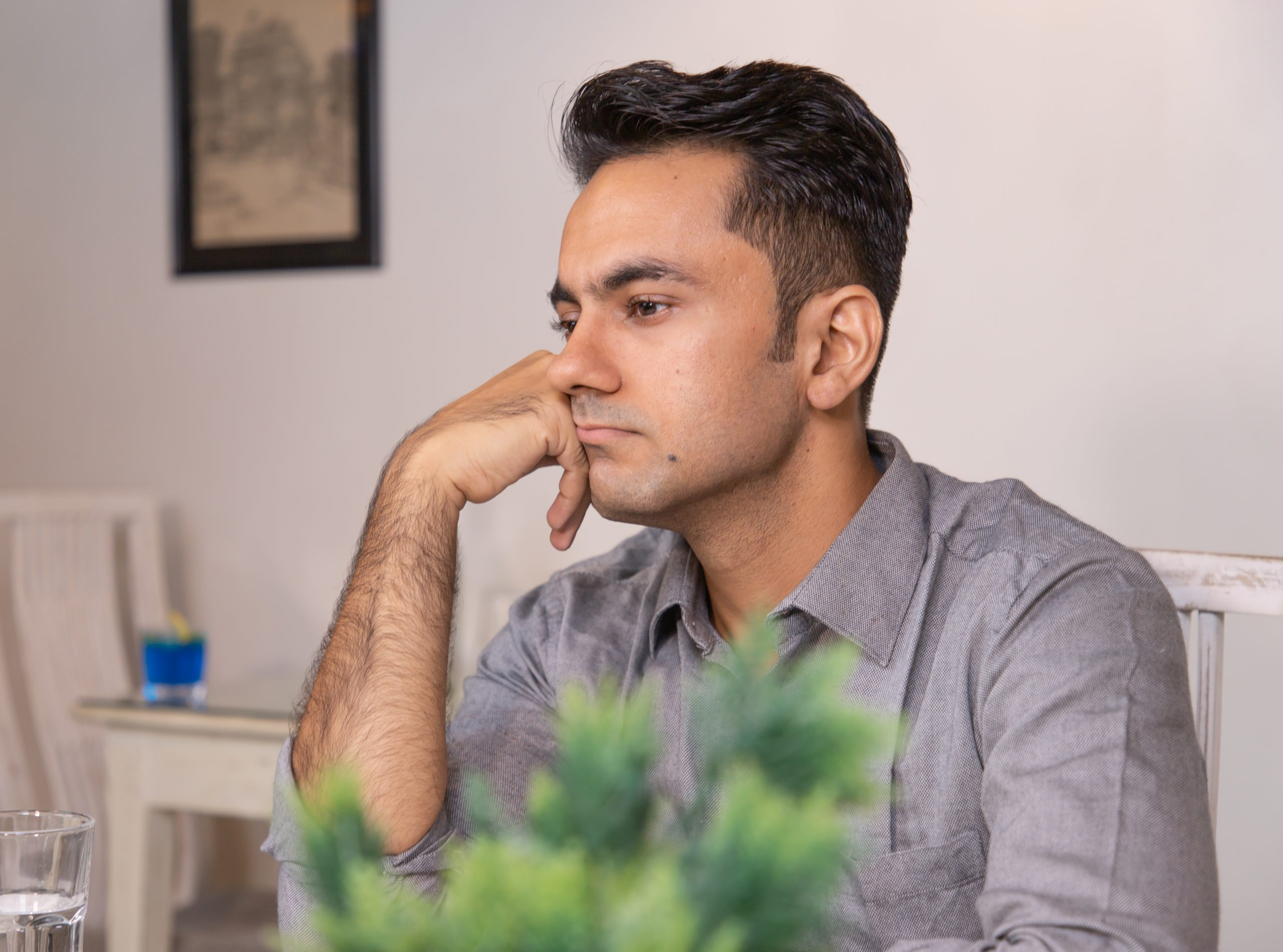 Sad looking man sitting in cafe