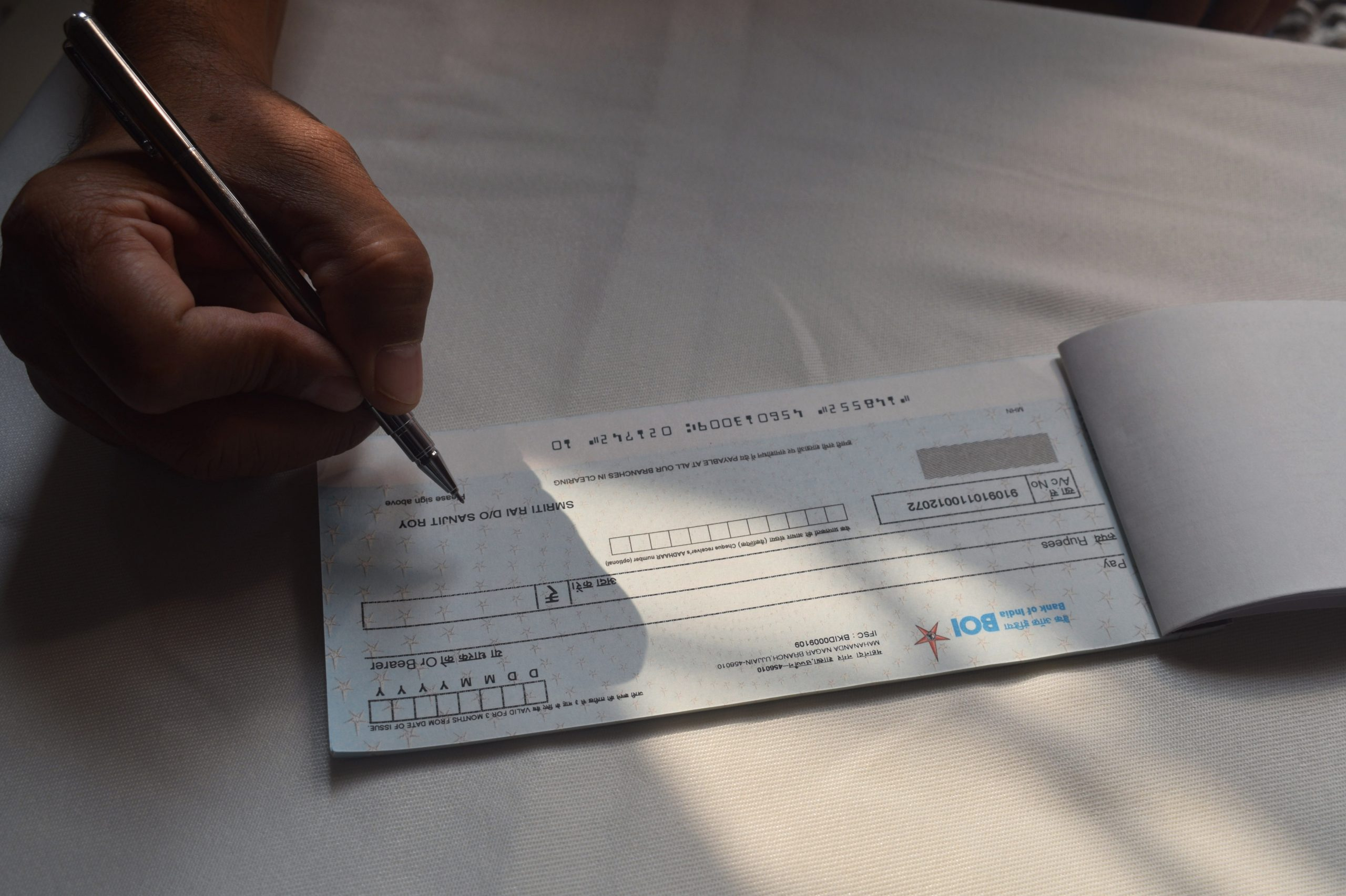 Signing a Cheque book