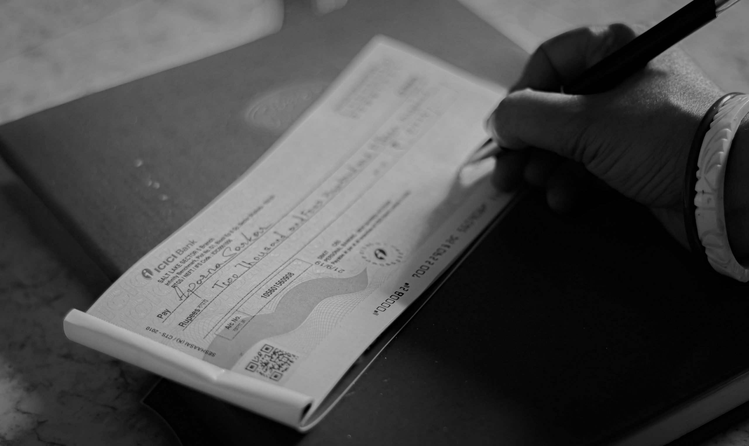 Signing a bank cheque
