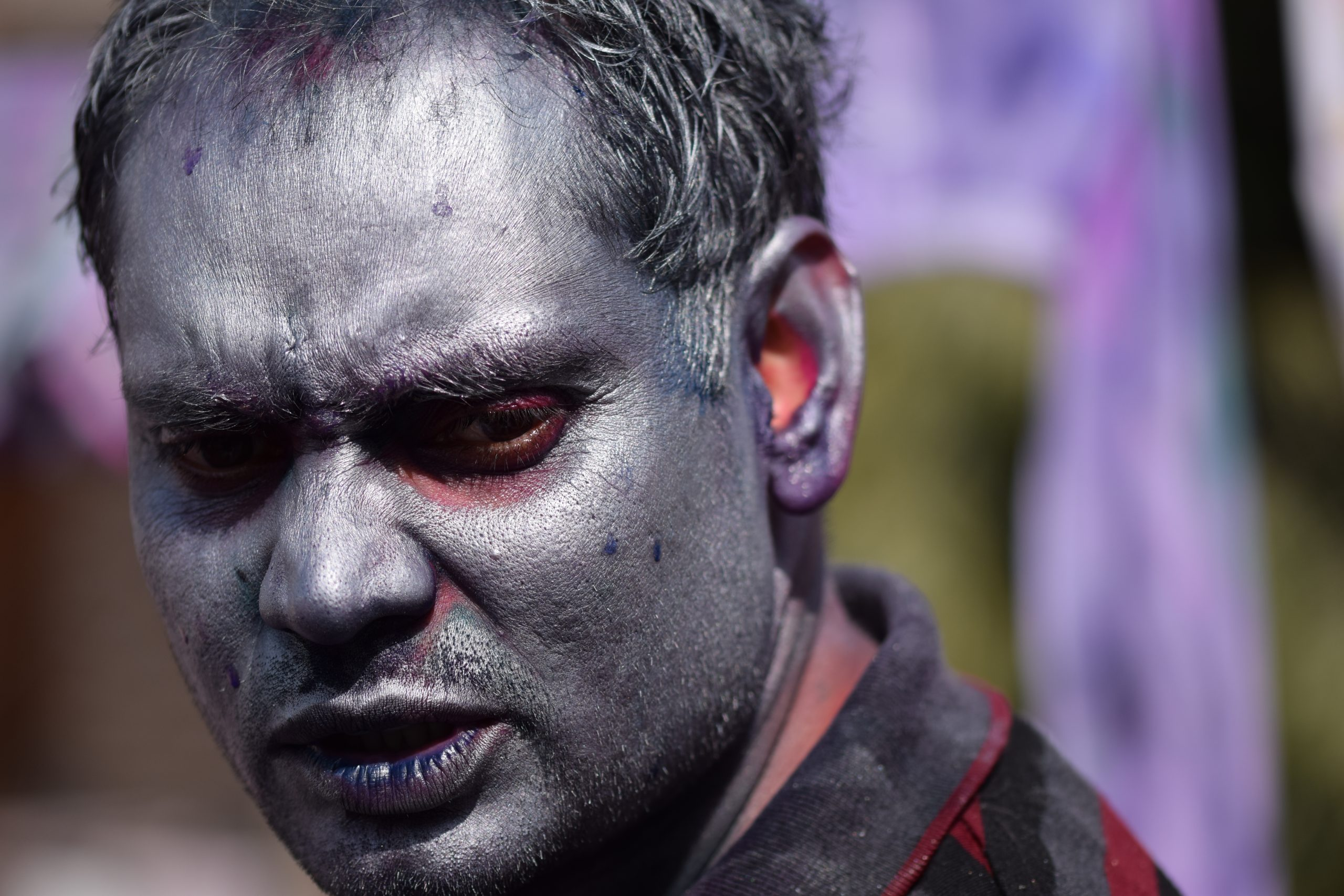 Silver color on face during Holi