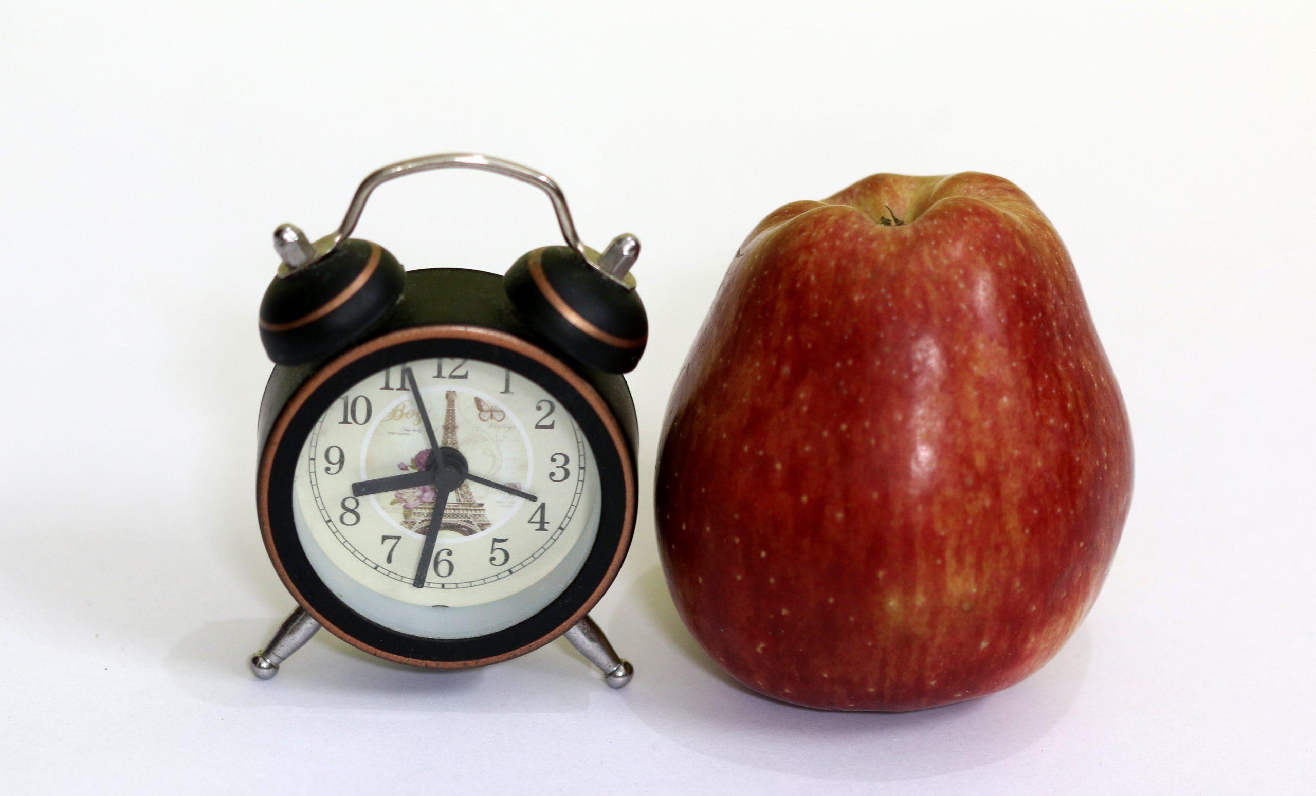 apple and an alarm clock
