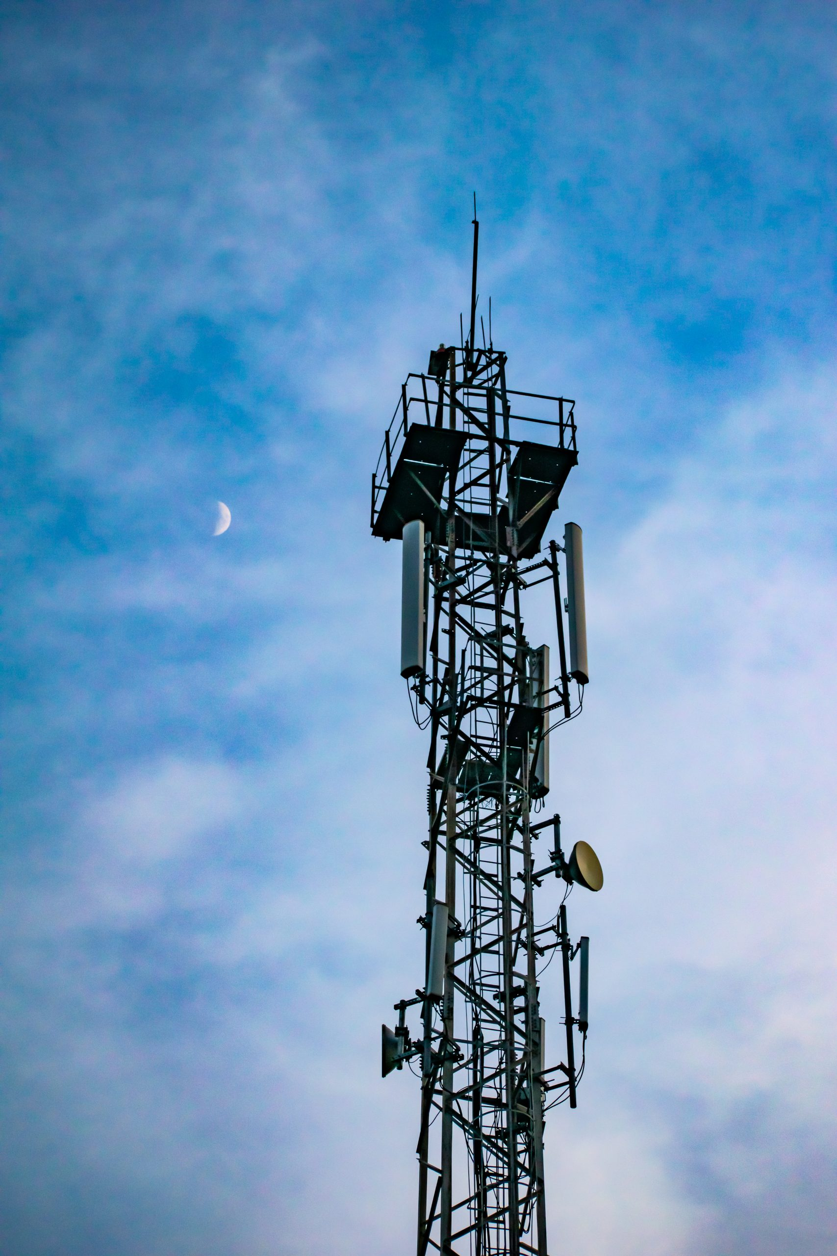 mobile tower and moon
