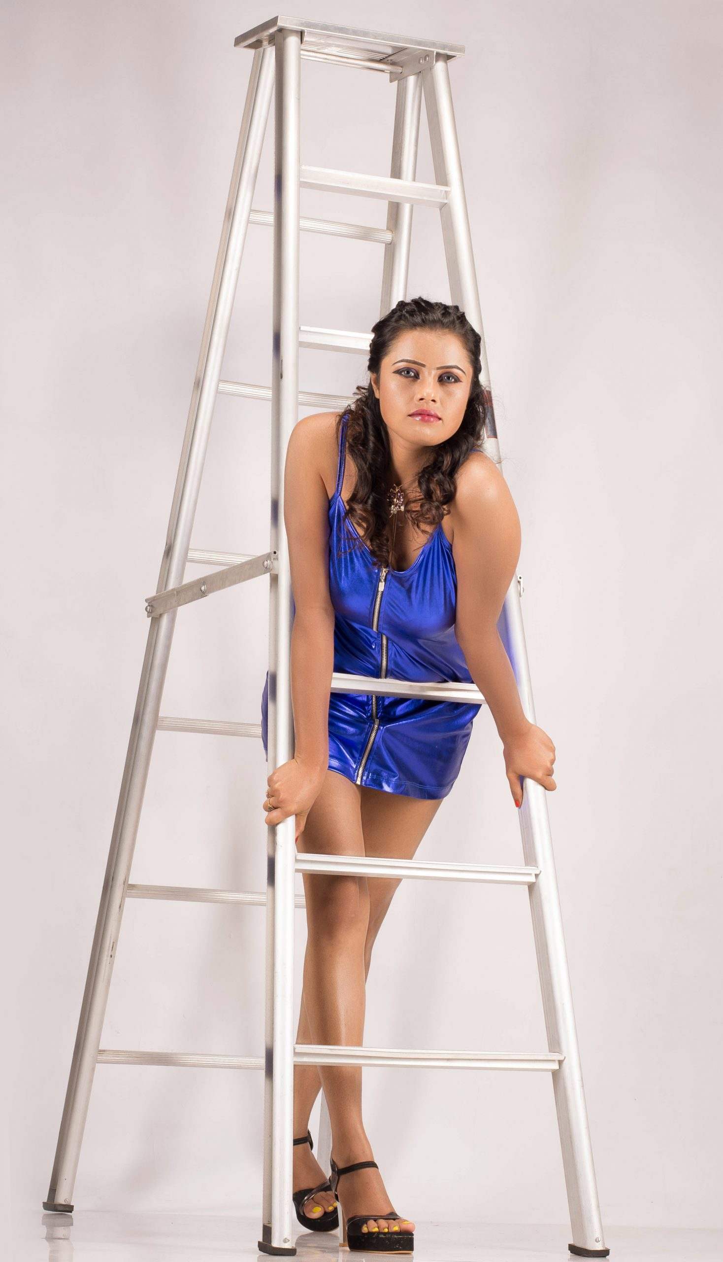 A girl on a ladder