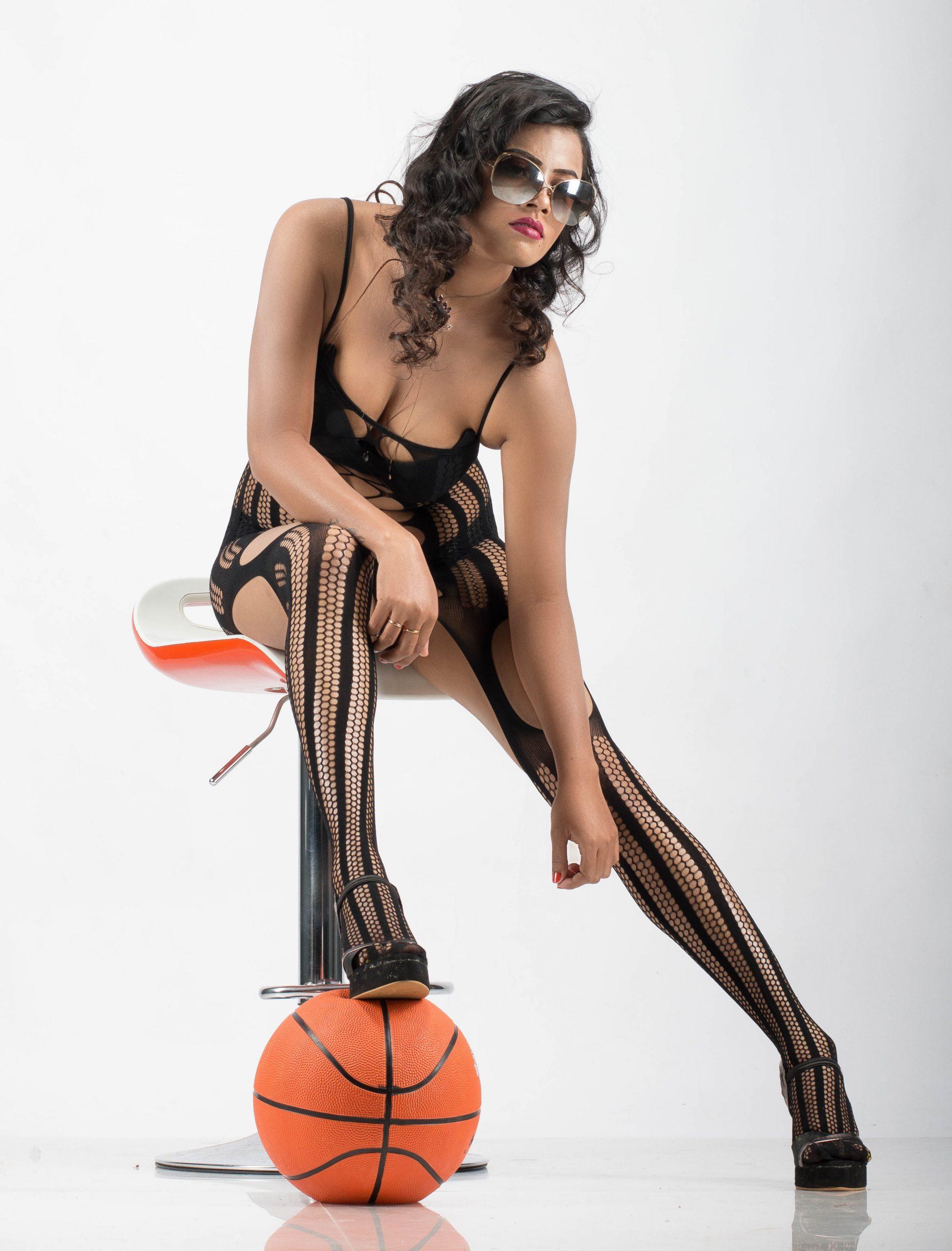 A fashion model with a basket ball