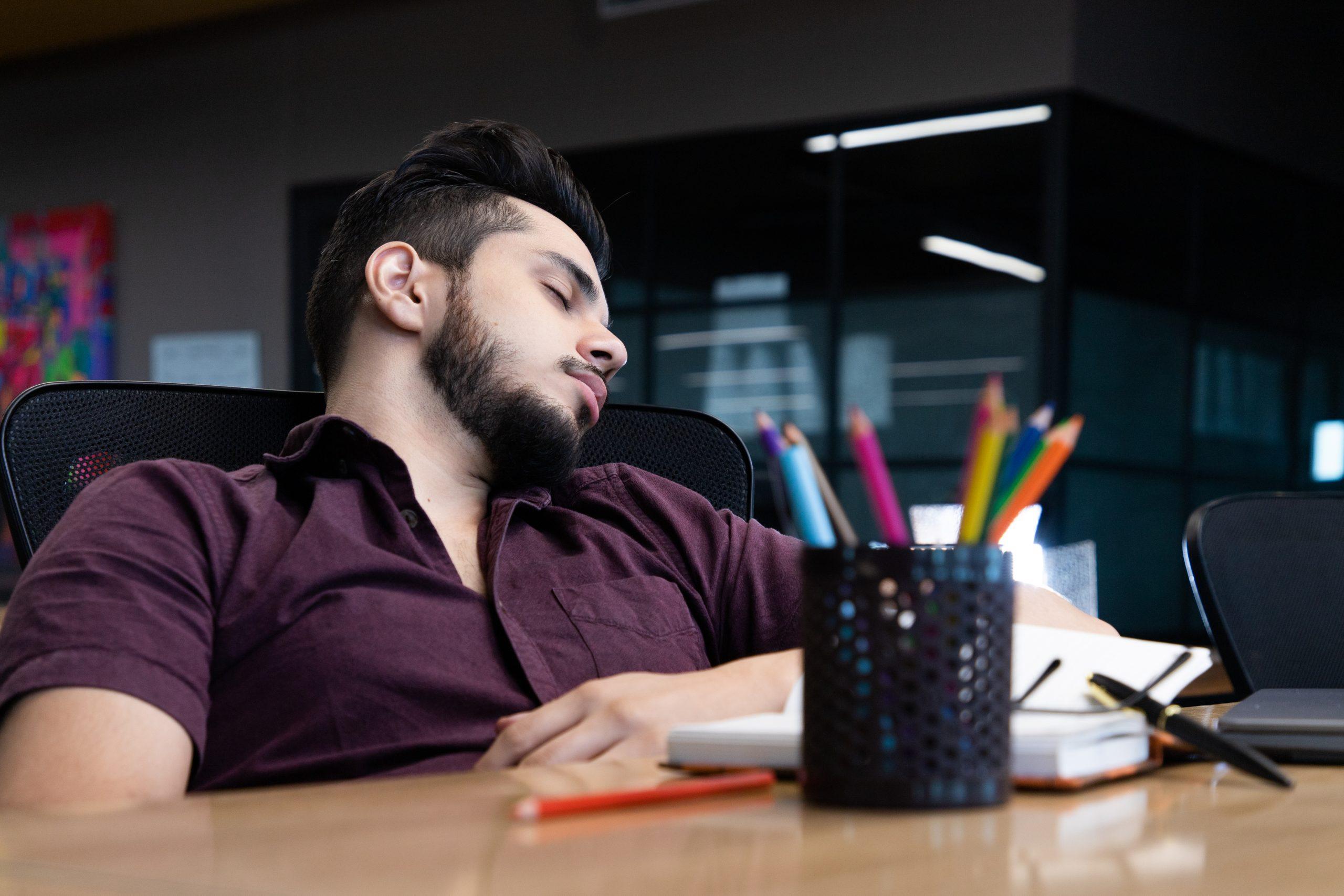 Tired employee sleeping