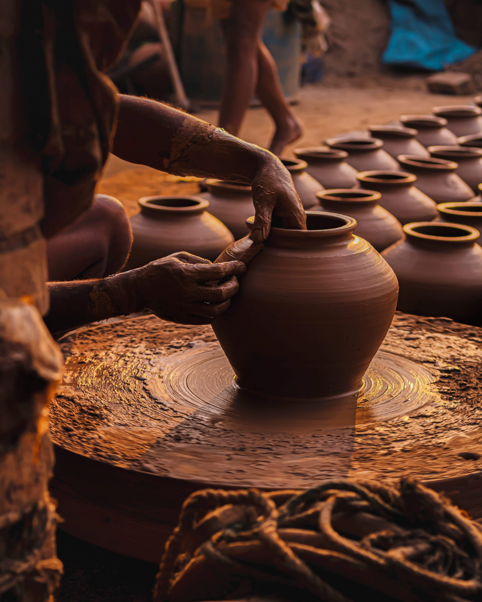 Potter making clay pot