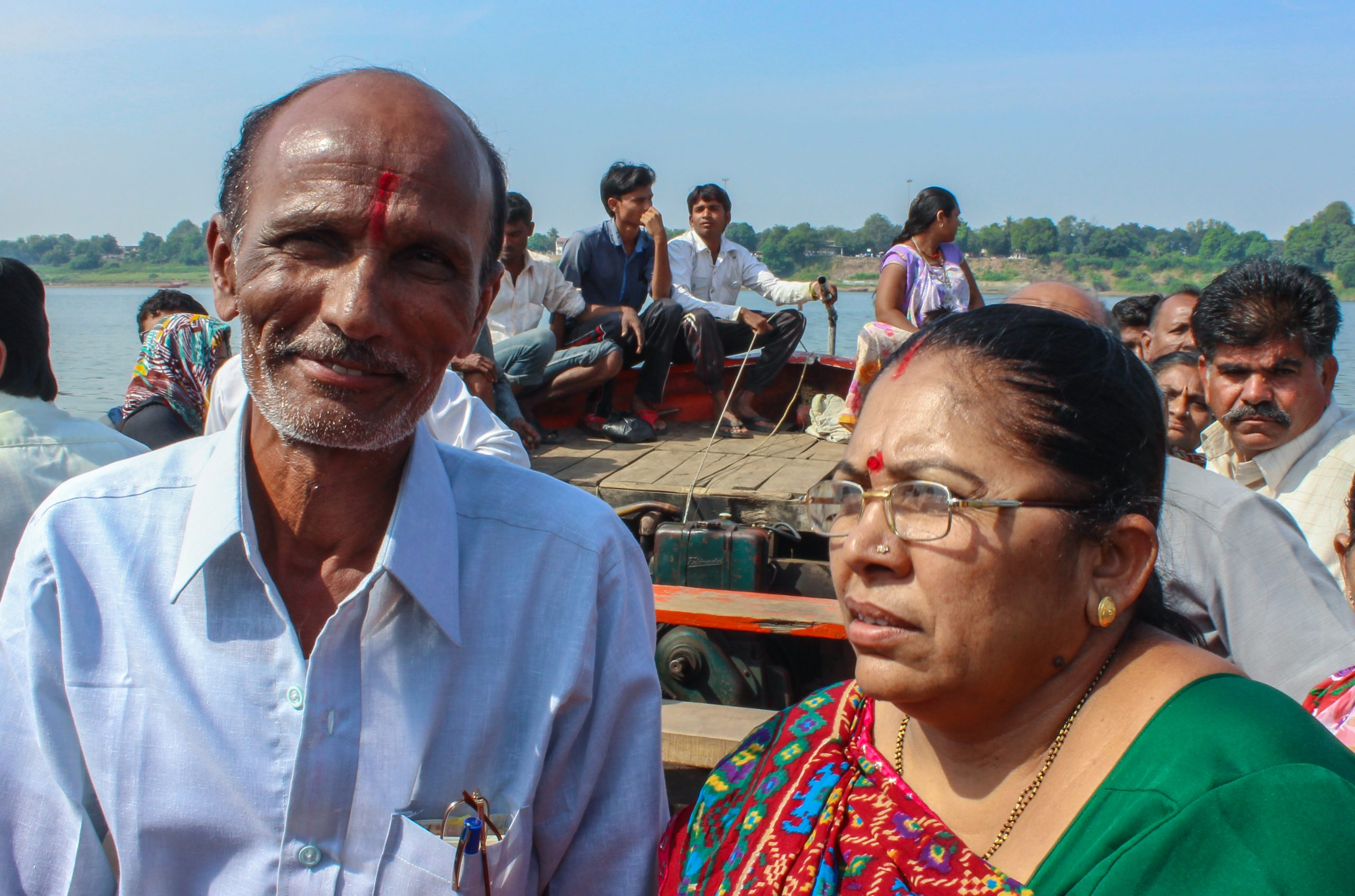 Old man and woman traveling on a boat.