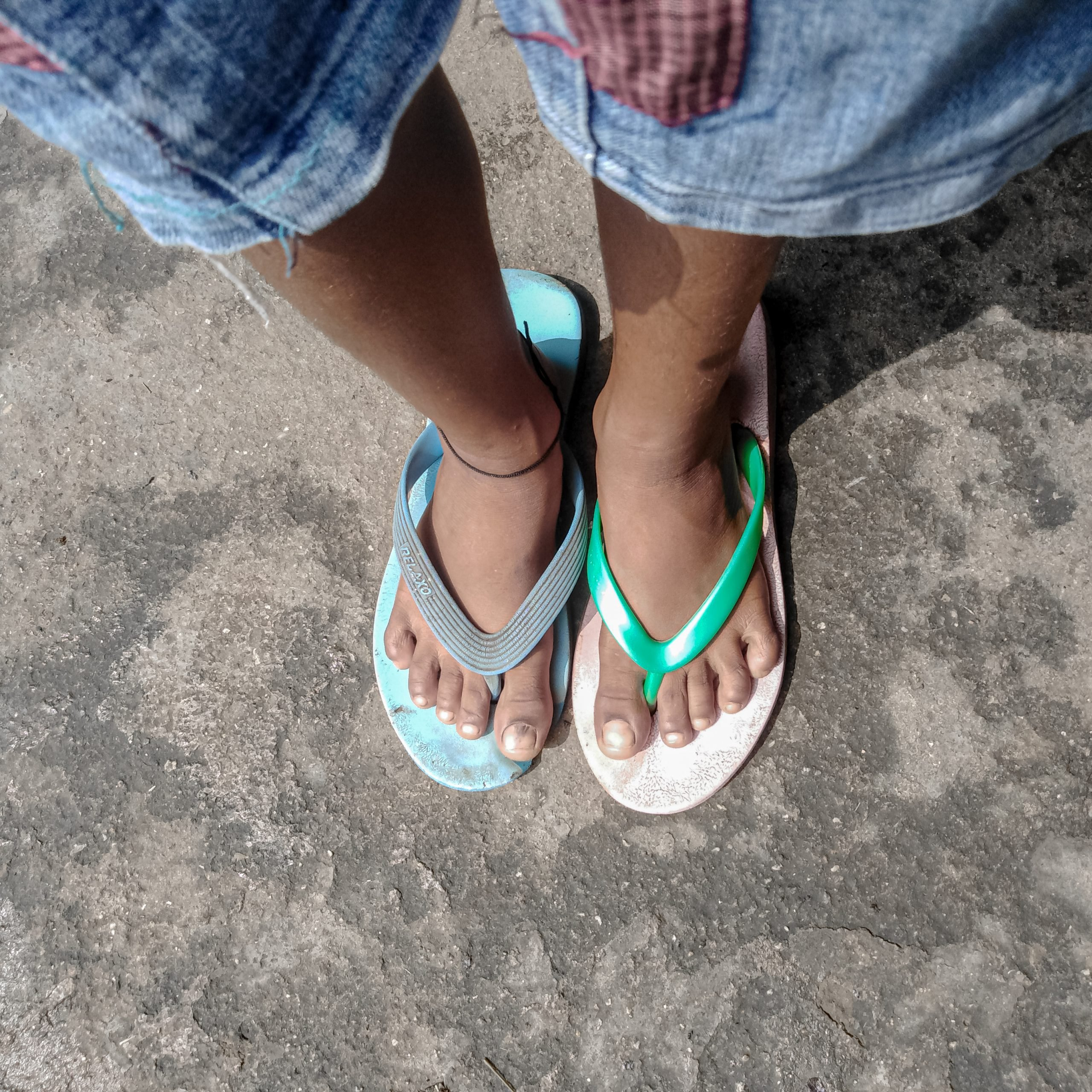 Wearing different slippers