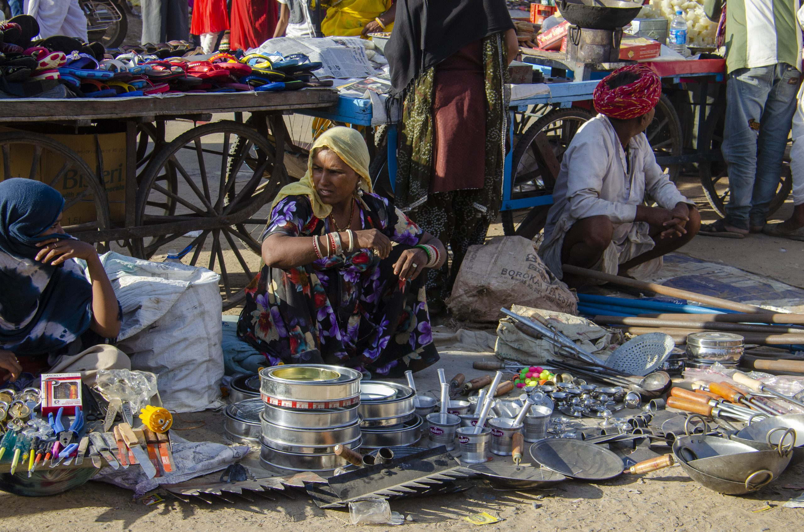Women selling utensil in a market