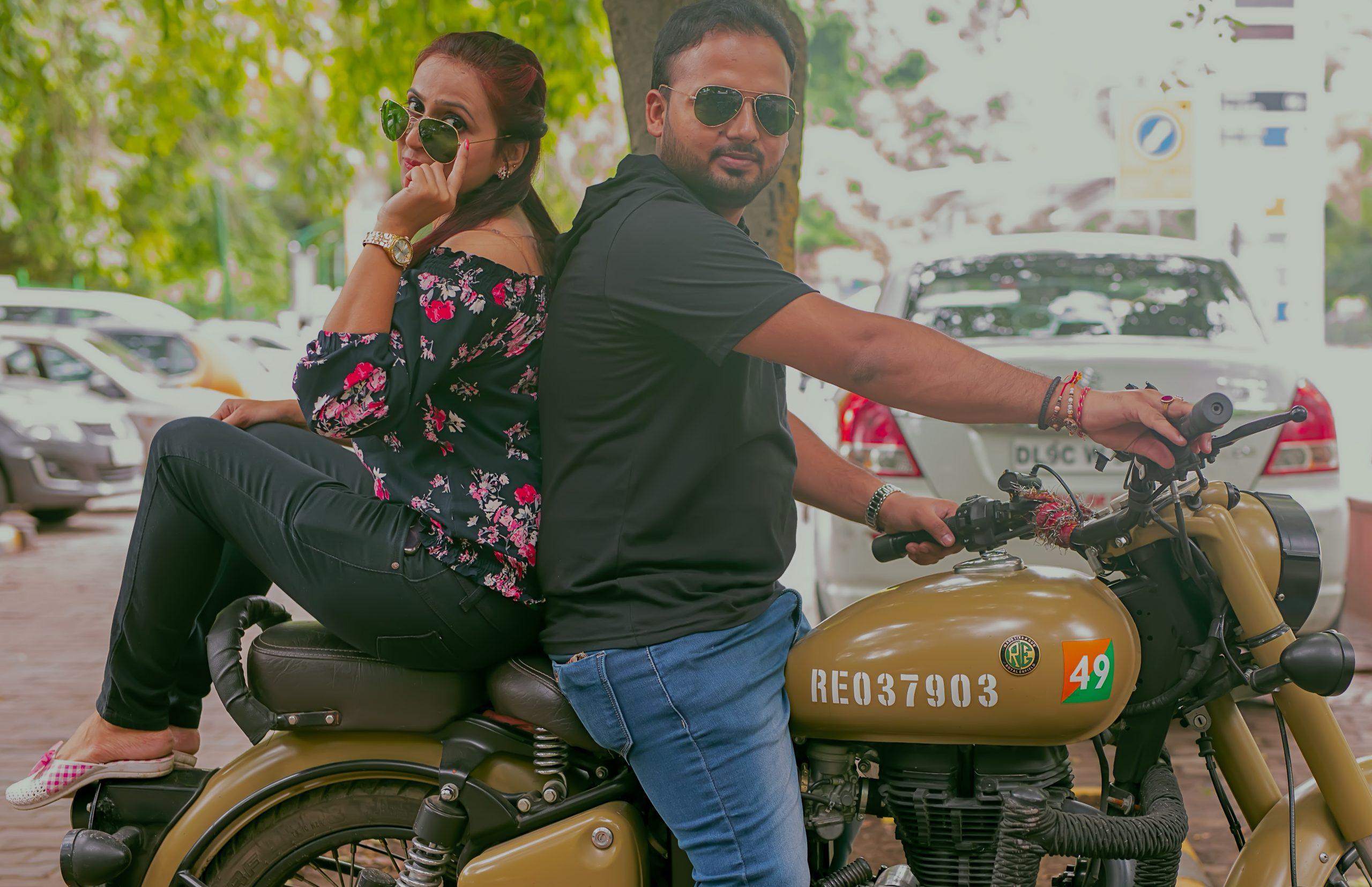 couple posing on motorbike