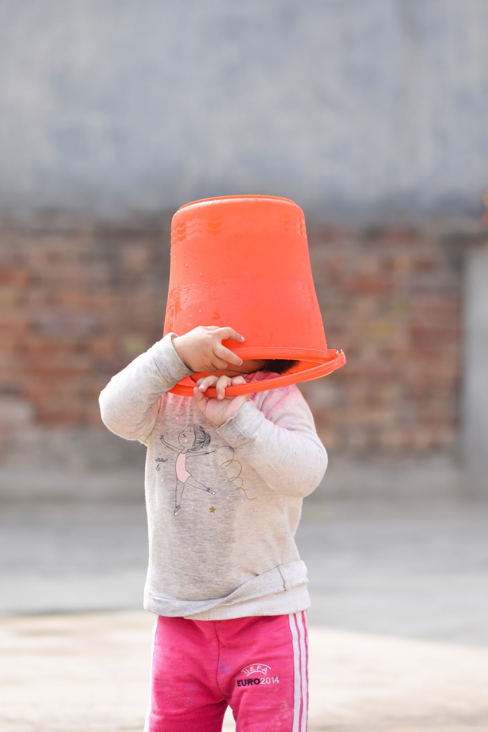 Kid Cover Face with bucket