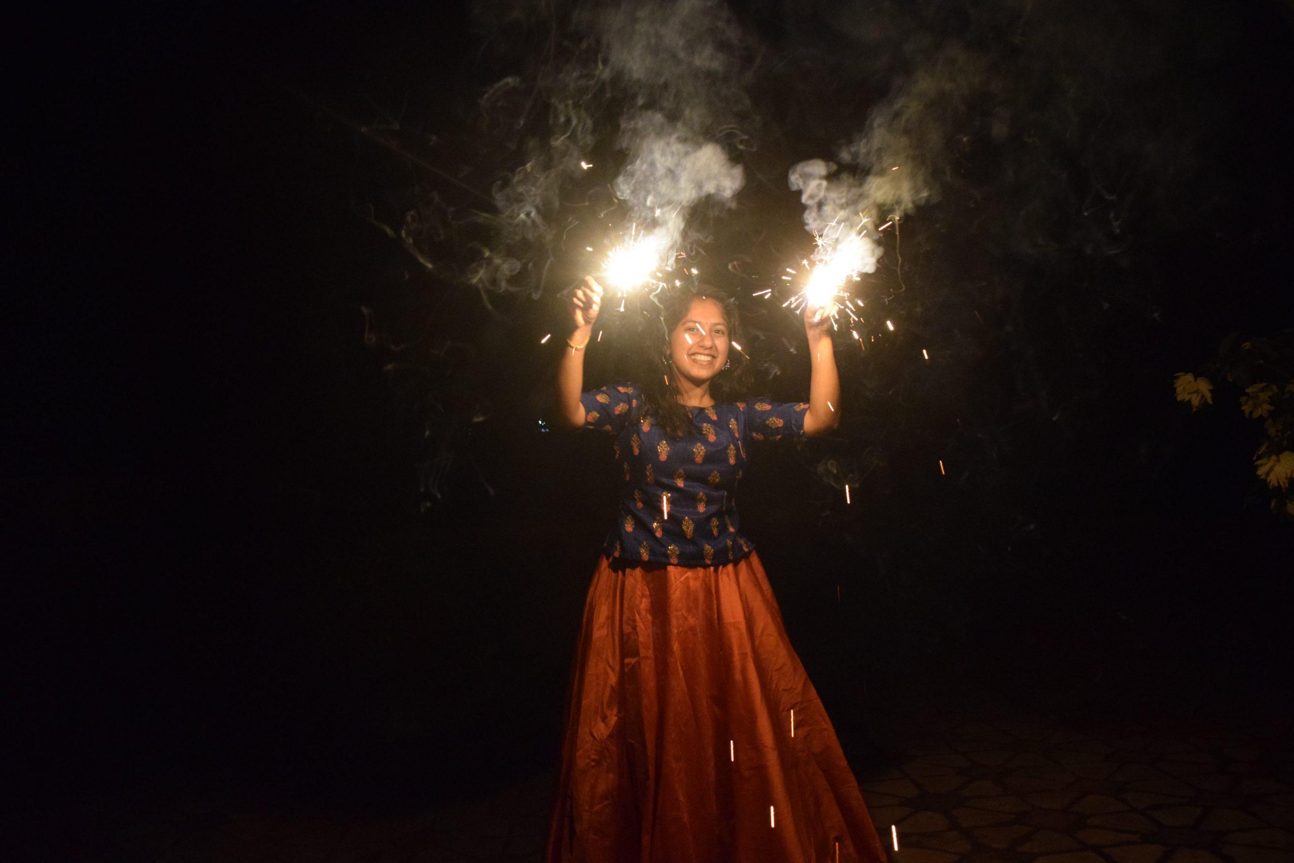 girl lighting fireworks