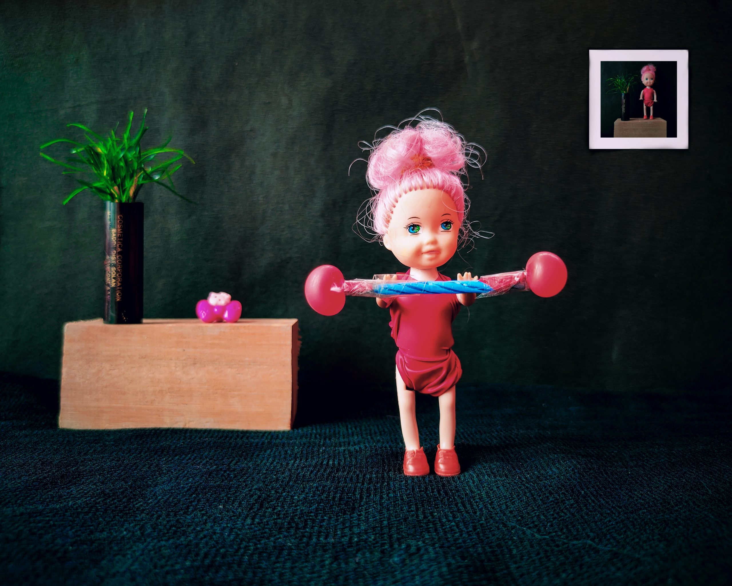 A doll lifting weight