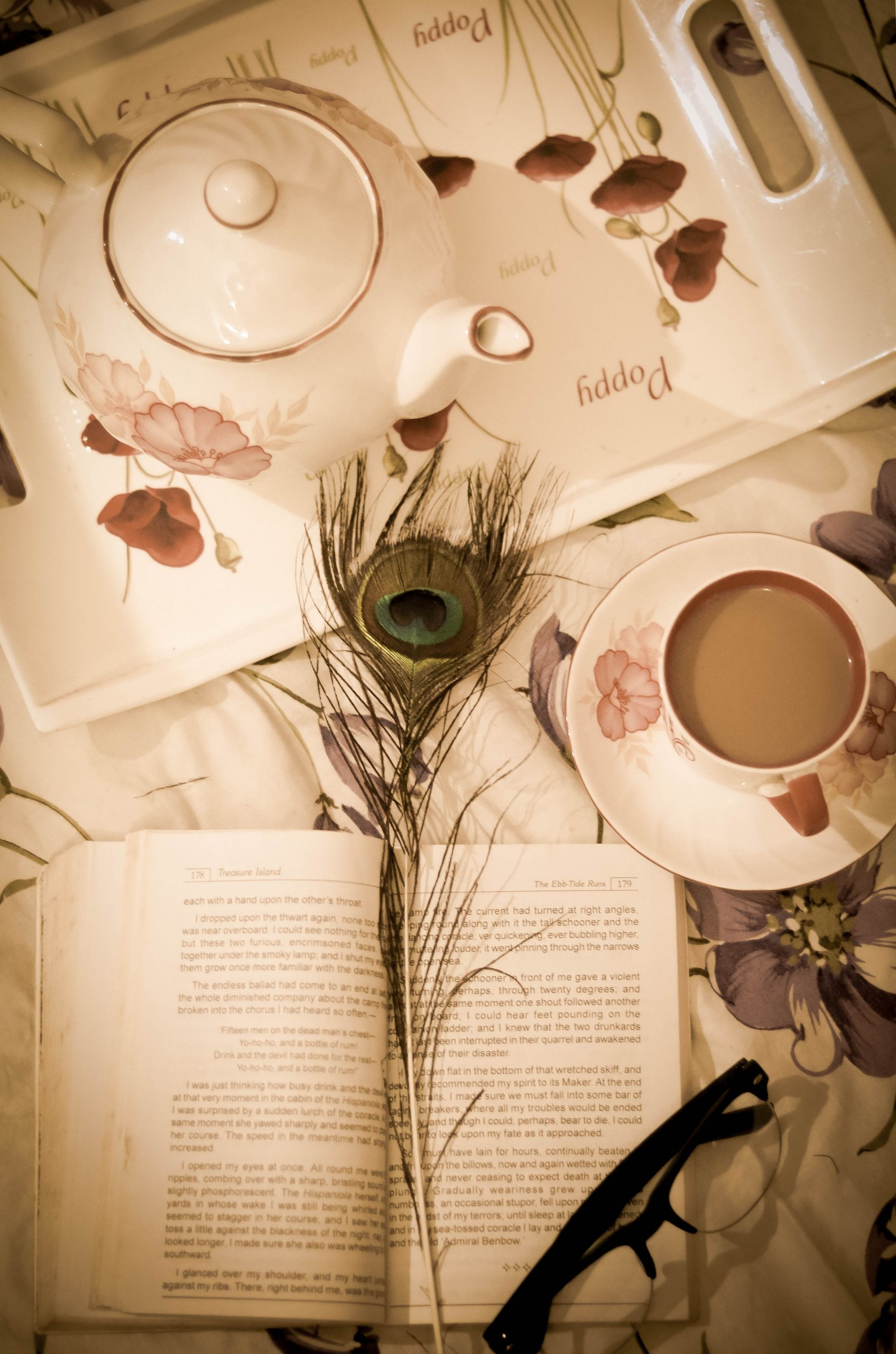 book, tea and spects