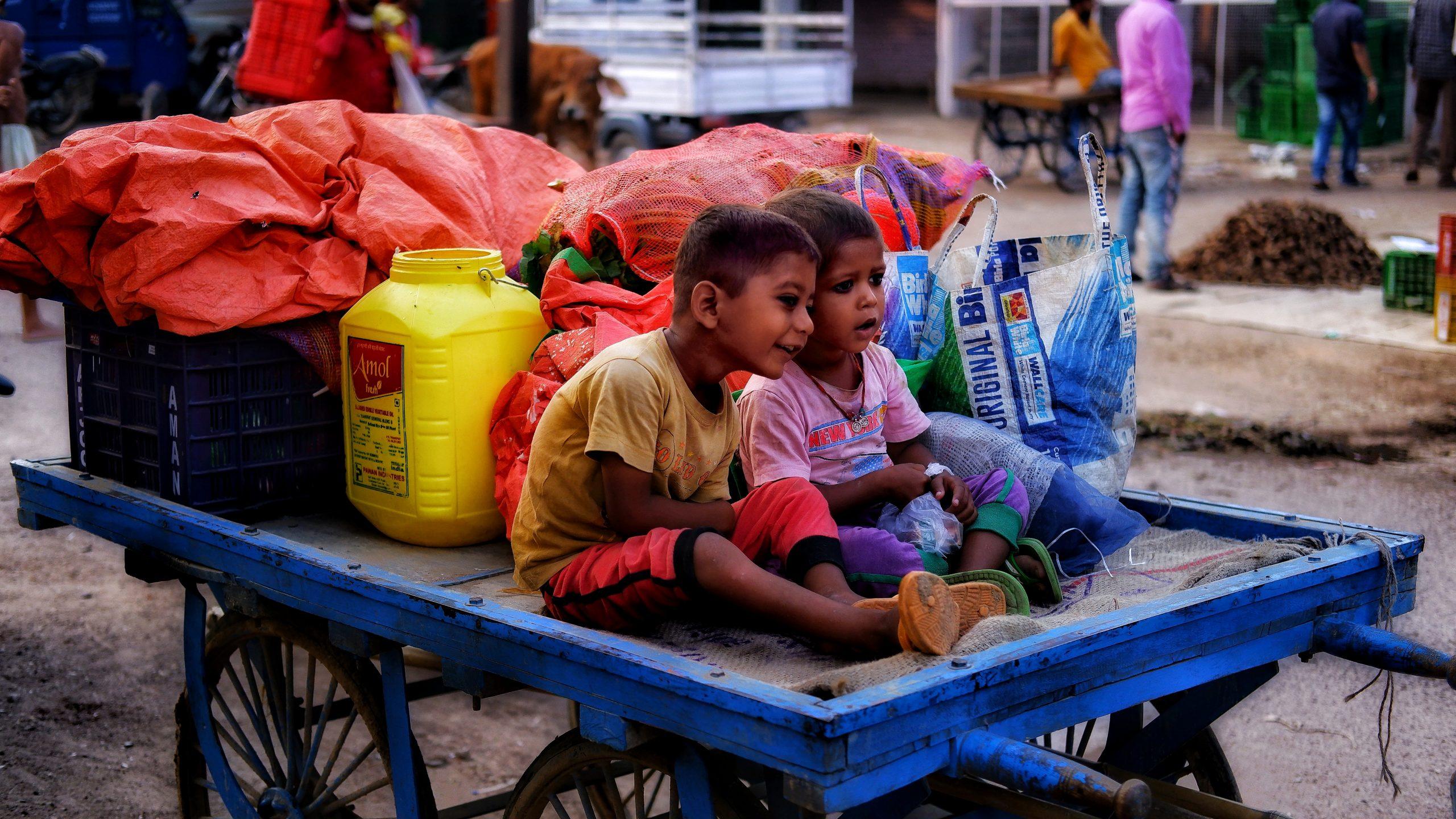 Little kids on a cart