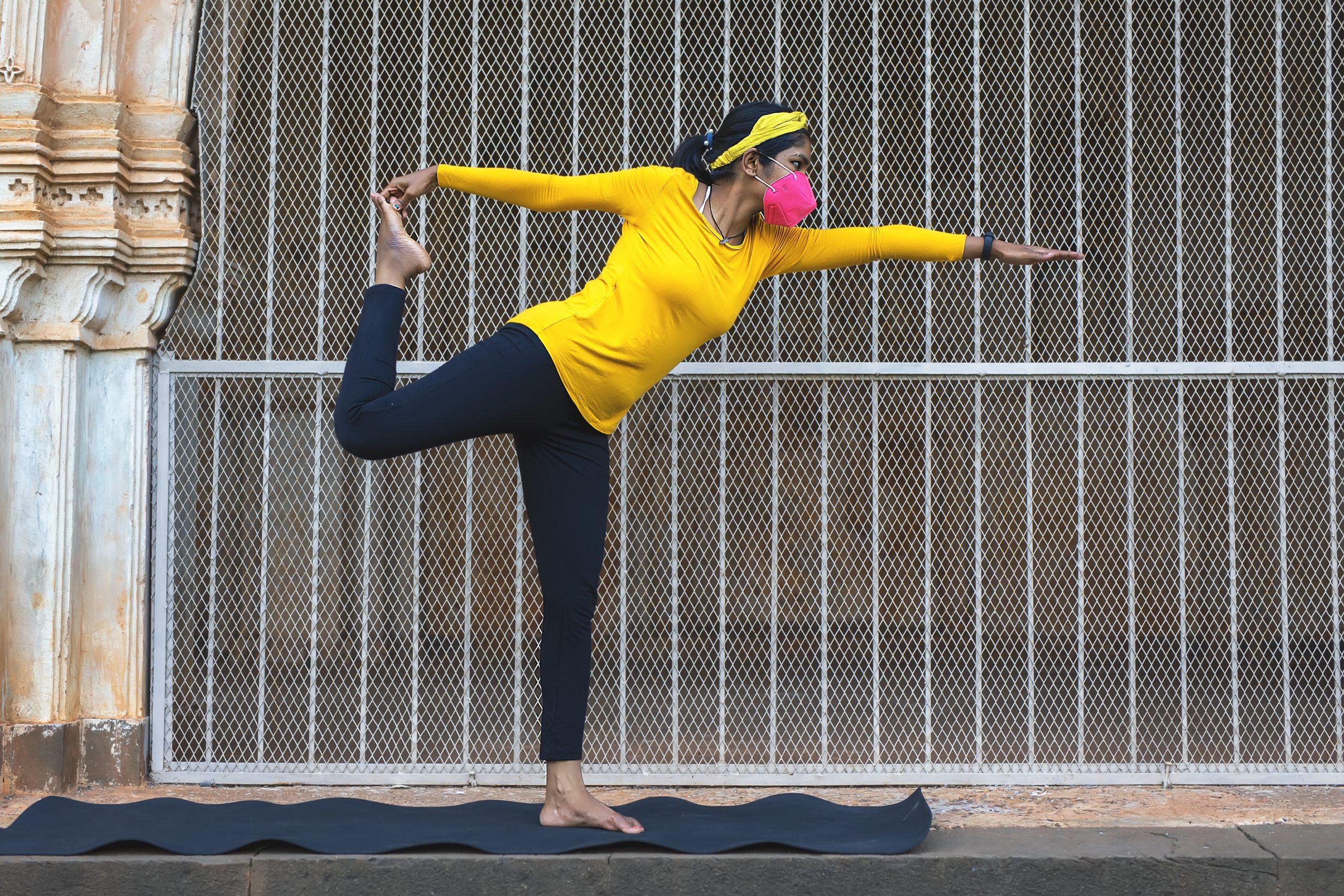 girl doing yoga with mask