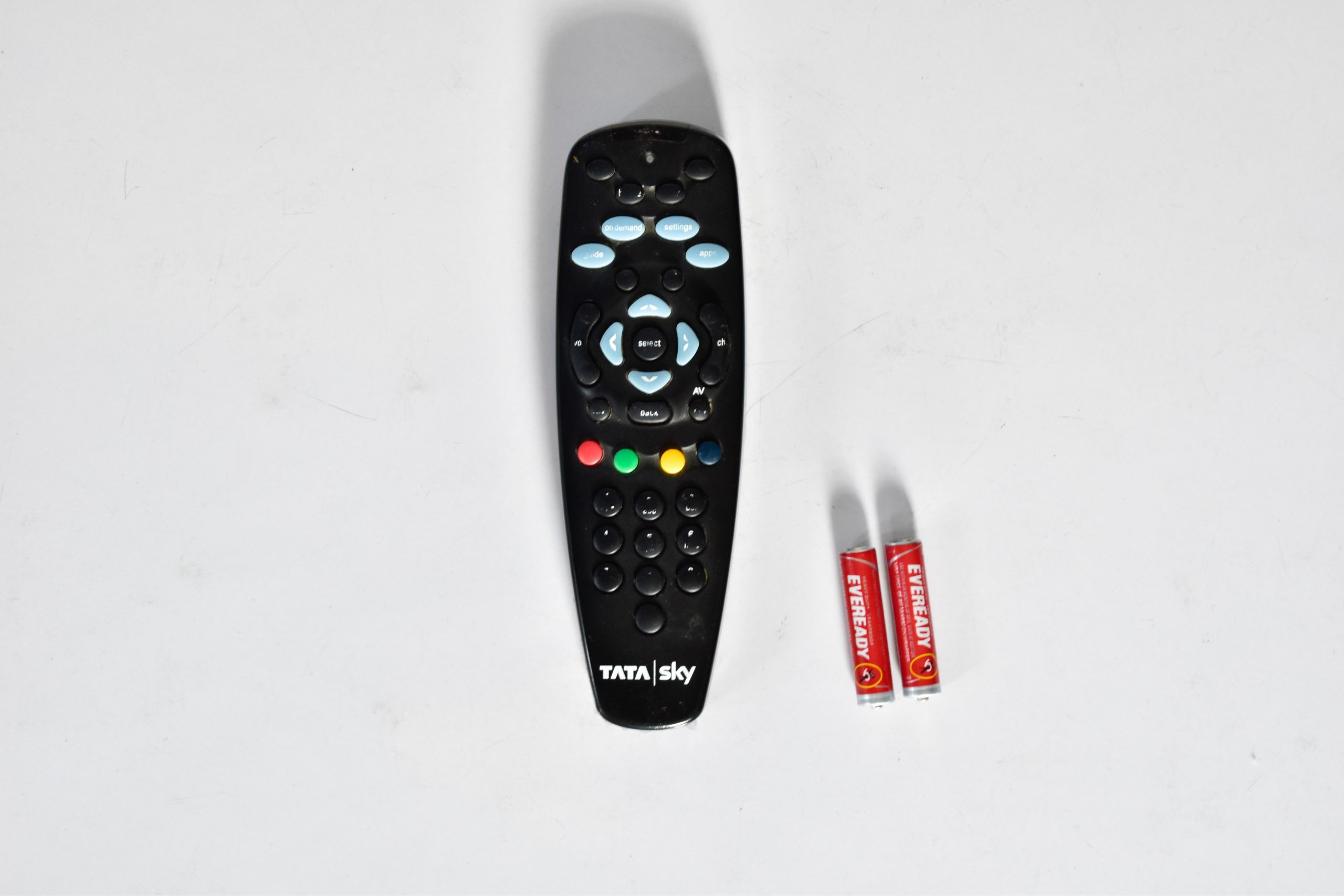 A TV remote and battery